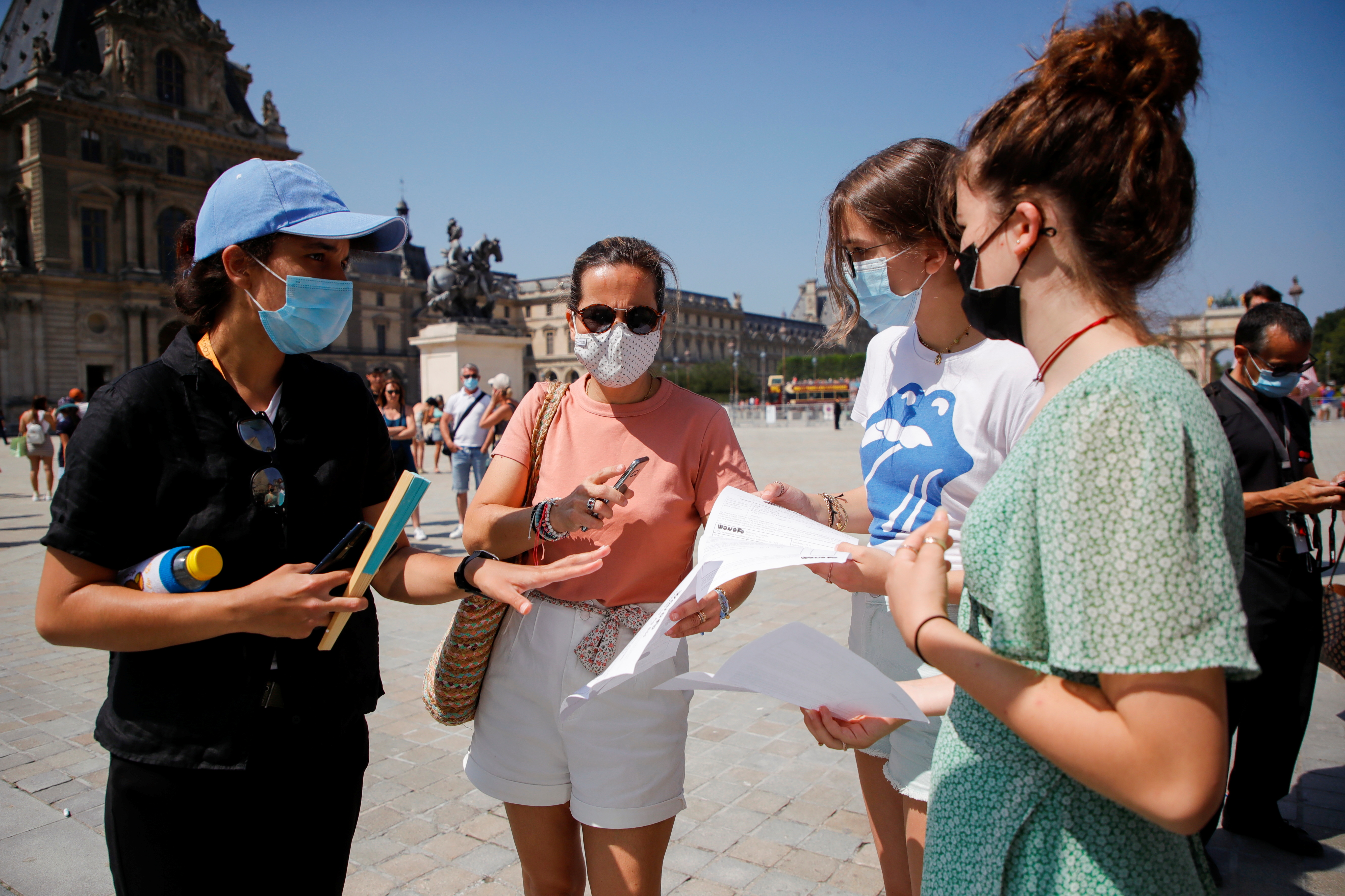 A security agent checks visitors' health passes in front of the Louvre museum entrance amid the coronavirus disease (COVID-19) outbreak in Paris, France, July 21, 2021. REUTERS/Sarah Meyssonnier