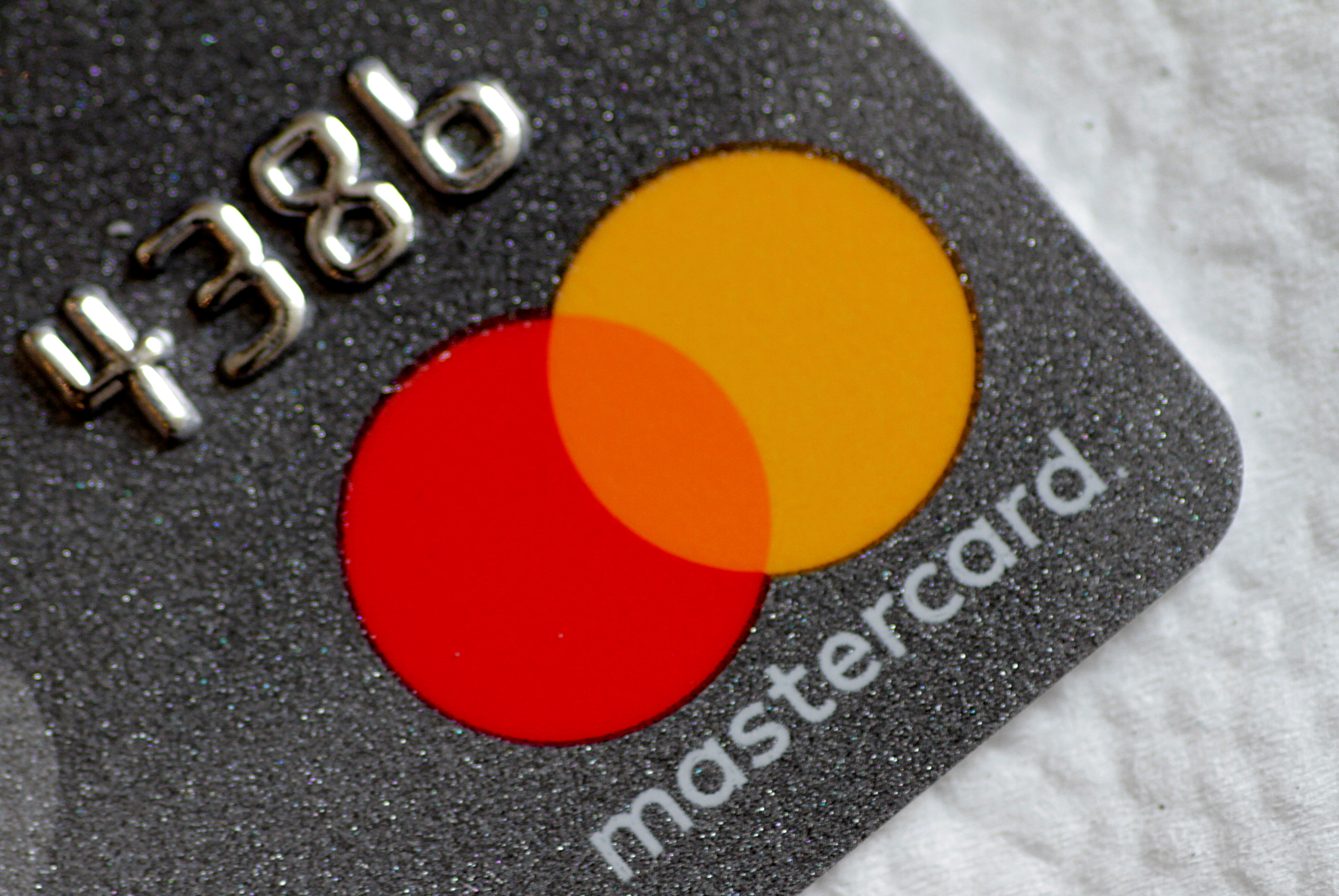 A Mastercard logo is seen on a credit card in this picture illustration August 30, 2017.   REUTERS/Thomas White