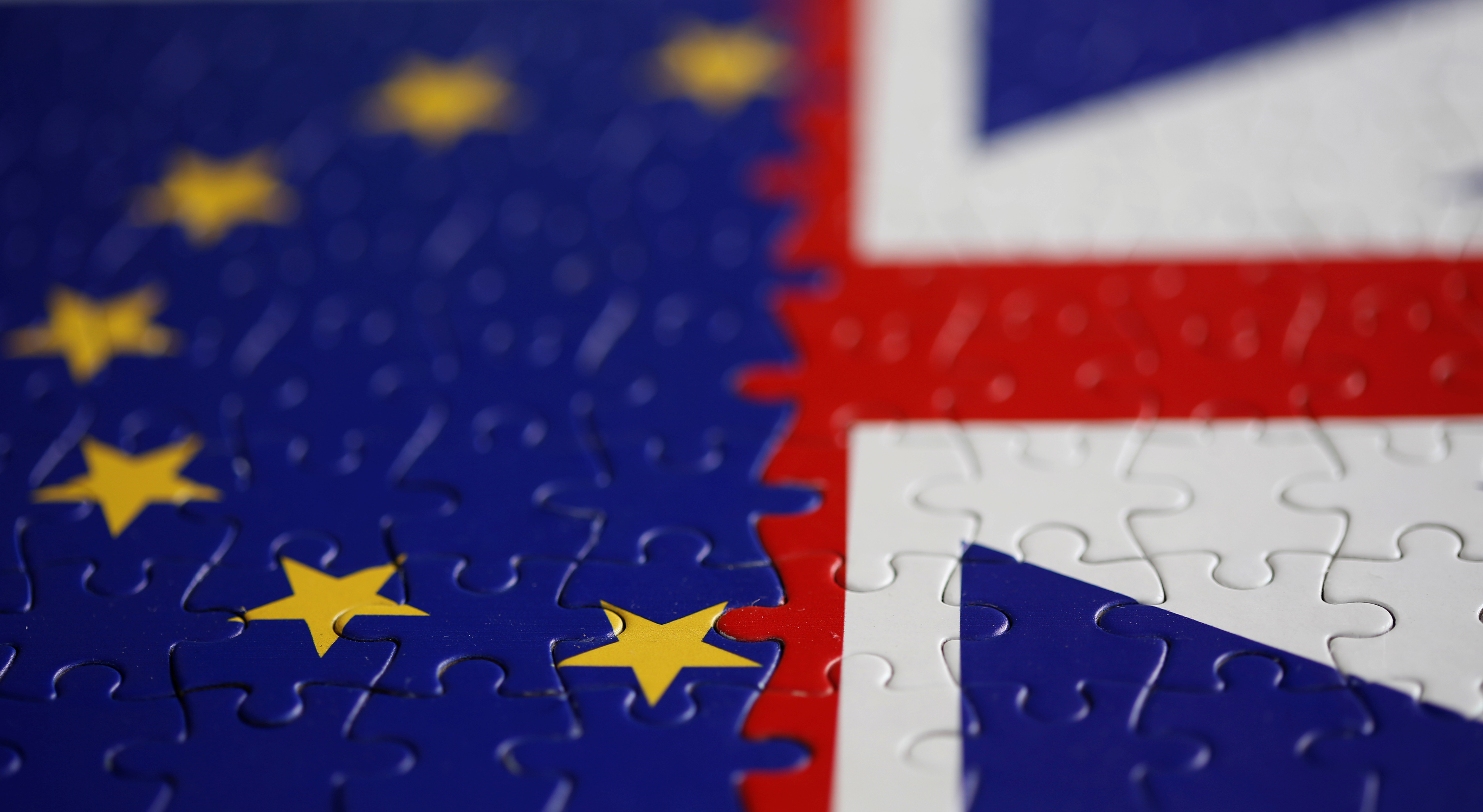 Puzzle with printed EU and UK flags is seen in this illustration taken November 13, 2019. REUTERS/Dado Ruvic/Illustration