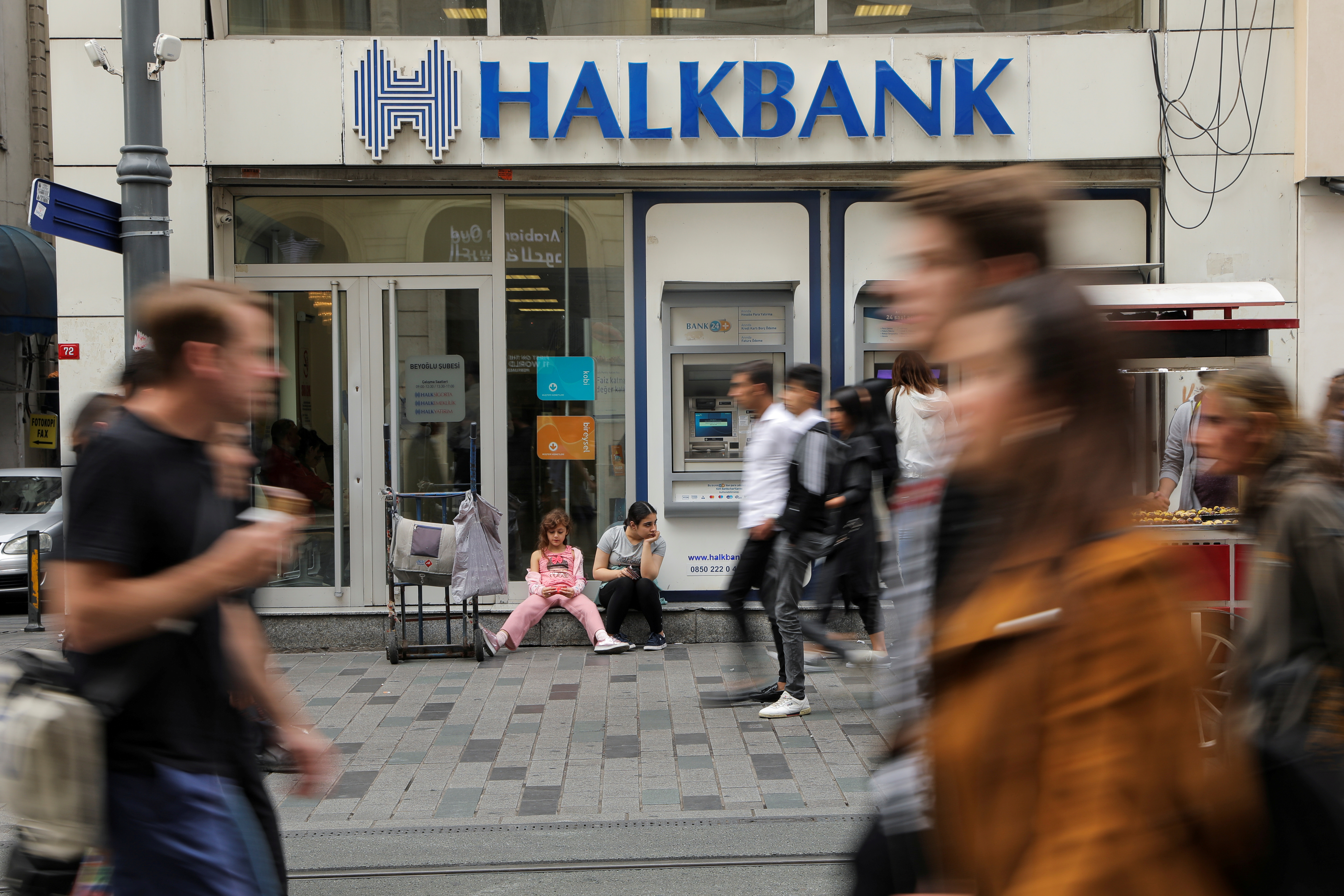 People walk past a branch of Halkbank in central Istanbul, Turkey, October 16, 2019. REUTERS/Huseyin Aldemir/File Photo