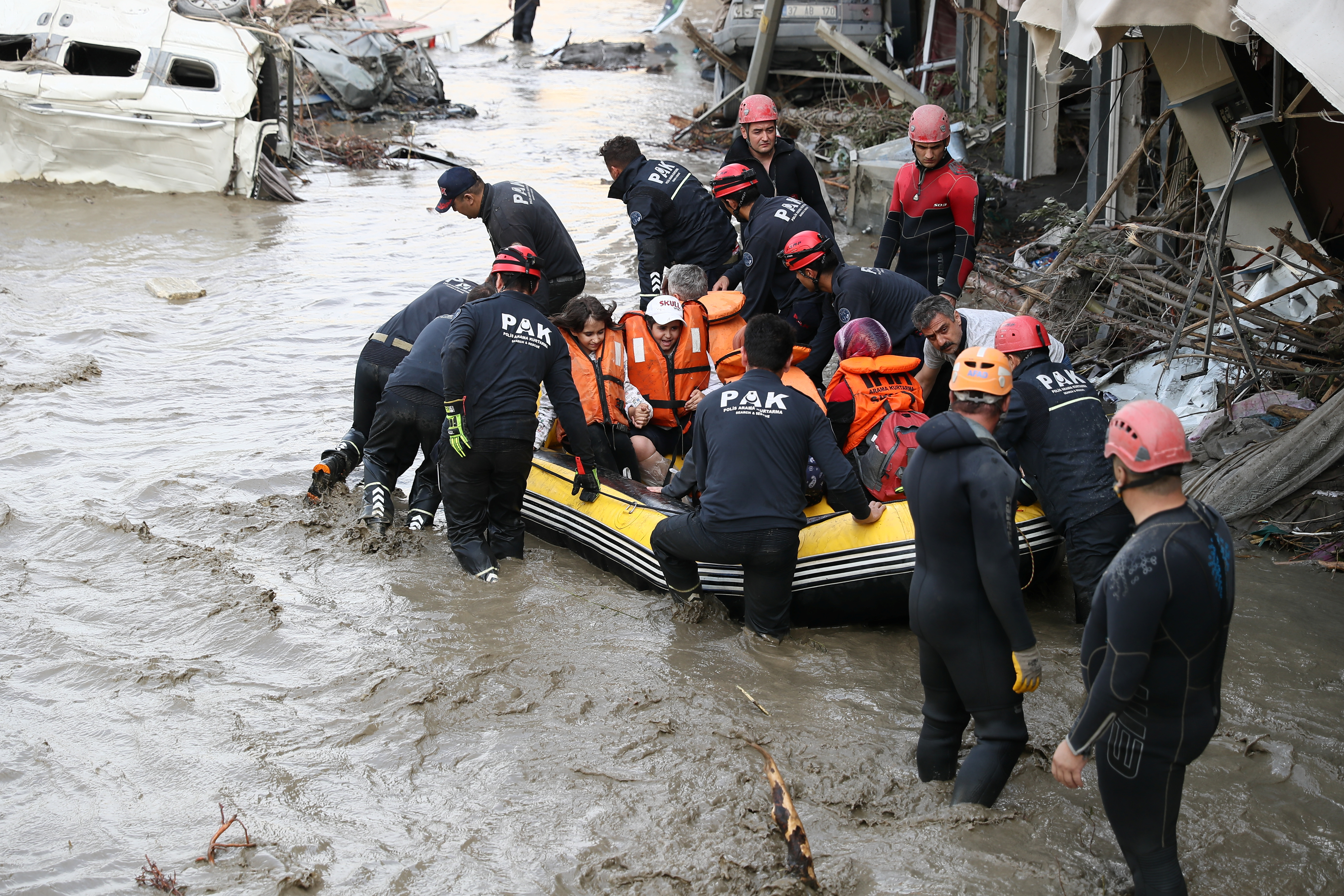 Search and Rescue team members evacuate locals during flash floods which have swept through towns in the Turkish Black Sea, in Bozkurt, a town in Kastamonu province, Turkey, August 12, 2021. Picture taken August 12, 2021. Onder Godez/Ministry of Interior Disaster and Emergency Management Authority (AFAD) Press Office/Handout via REUTERS