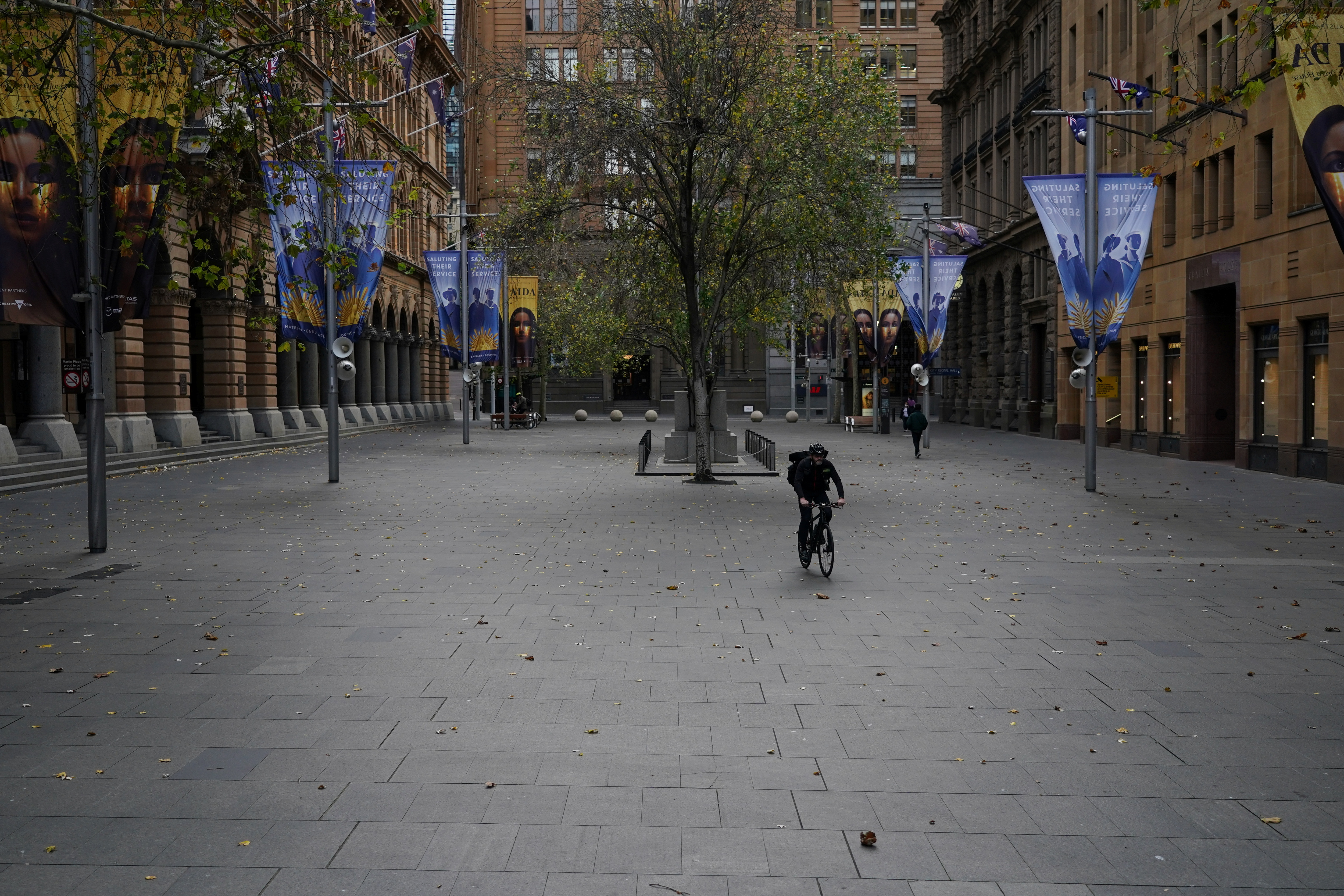A lone cyclist rides through the empty Martin Place in the city centre during a lockdown to curb the spread of a coronavirus disease (COVID-19) outbreak in Sydney, Australia, July 28, 2021.  REUTERS/Loren Elliott