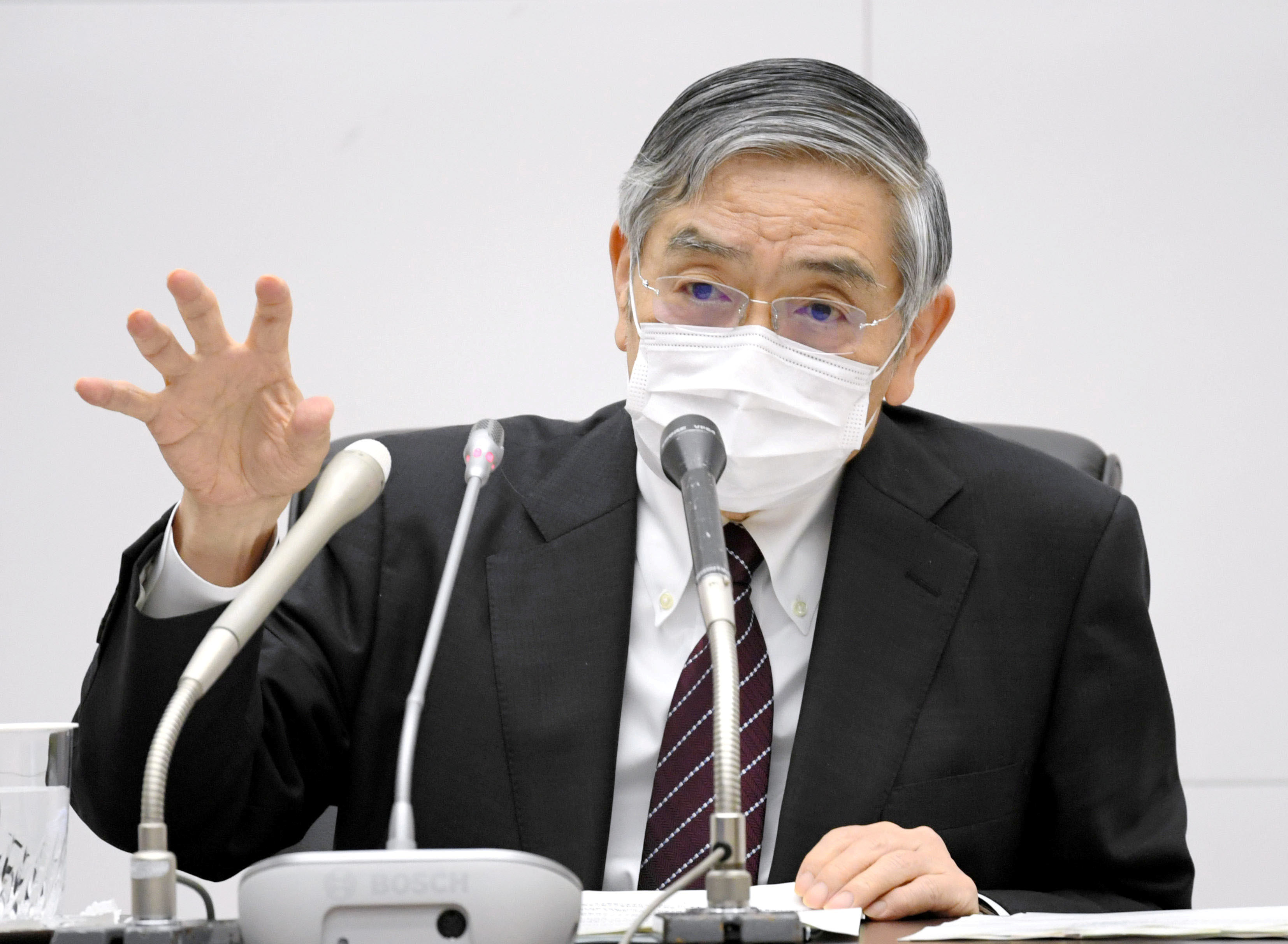 Bank of Japan Governor Haruhiko Kuroda wearing a protective face mask attends a news conference as the spread of the coronavirus disease (COVID-19) continues in Tokyo, Japan, April 27, 2020, in this photo released by Kyodo. Mandatory credit Kyodo/via REUTERS