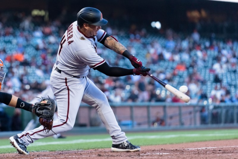 Jun 15, 2021; San Francisco, California, USA; Arizona Diamondbacks third baseman Asdrubal Cabrera (14) hits an RBI single against the San Francisco Giants in the second inning at Oracle Park. Mandatory Credit: John Hefti-USA TODAY Sports