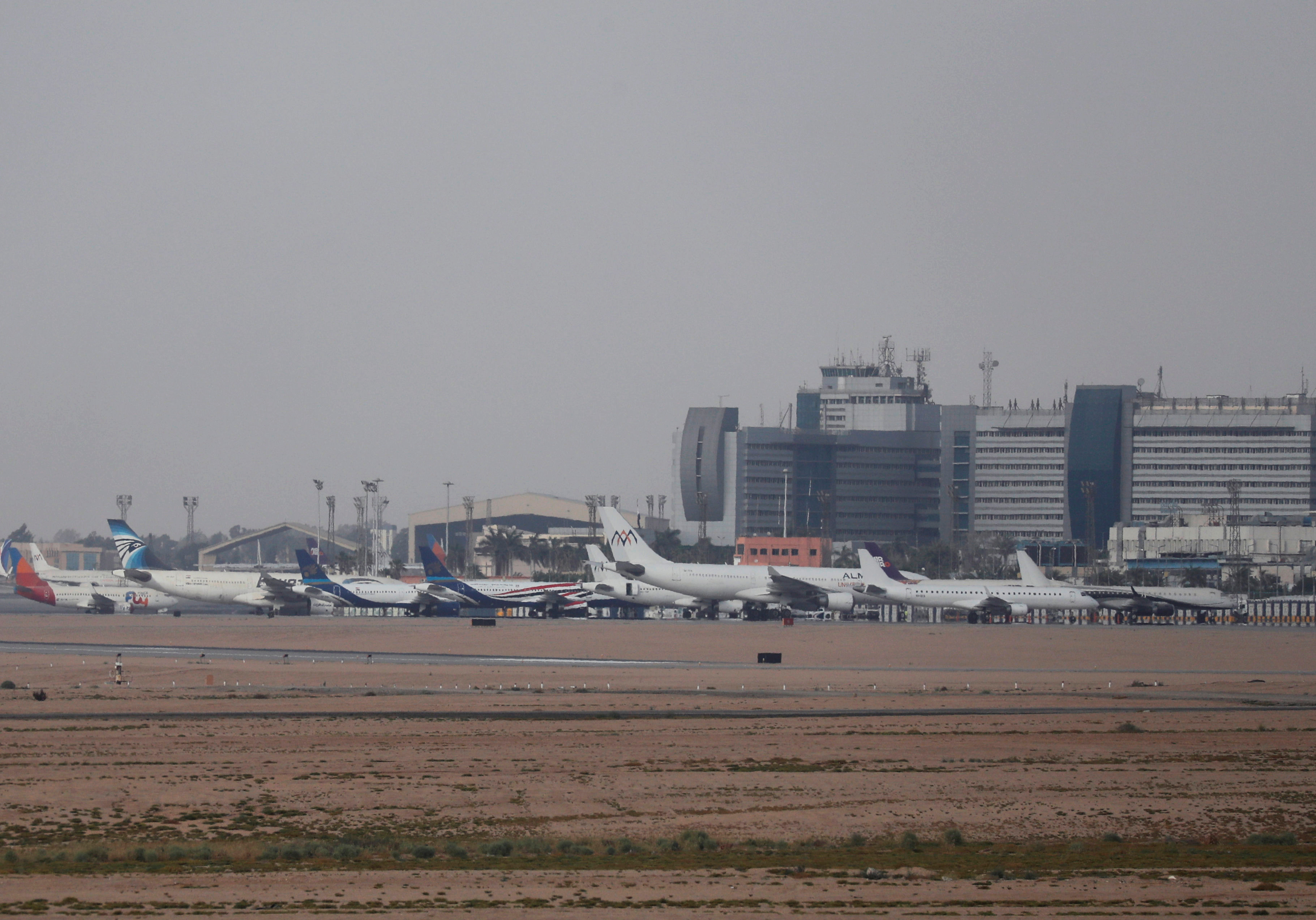 An EgyptAir plane is parked next to other planes on the runway of the Cairo International Airport, amid concerns over the coronavirus disease (COVID-19) in Cairo, Egypt June 16, 2020. Picture taken June 16, 2020. REUTERS/Amr Abdallah Dalsh