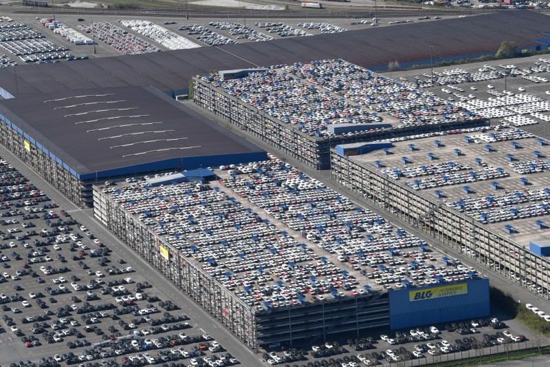Cars intended for export wait at the port for loading, as the spread of the coronavirus disease (COVID-19) continues in Bremerhaven, Germany, April 24, 2020. REUTERS/Fabian Bimmer/File Photo