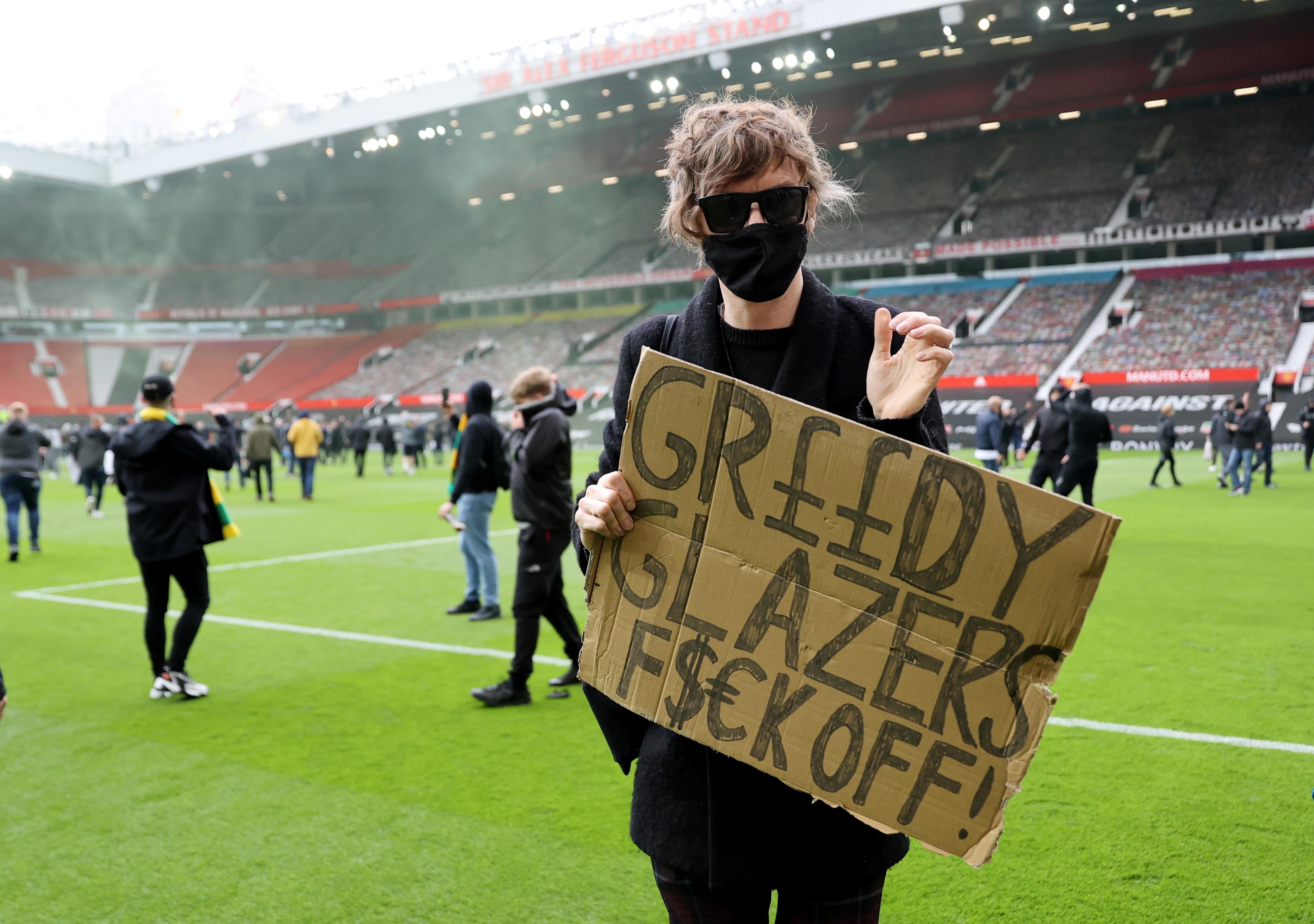 Protesting Man United fans break into Old Trafford and invade pitch ahead  of Liverpool match | Reuters