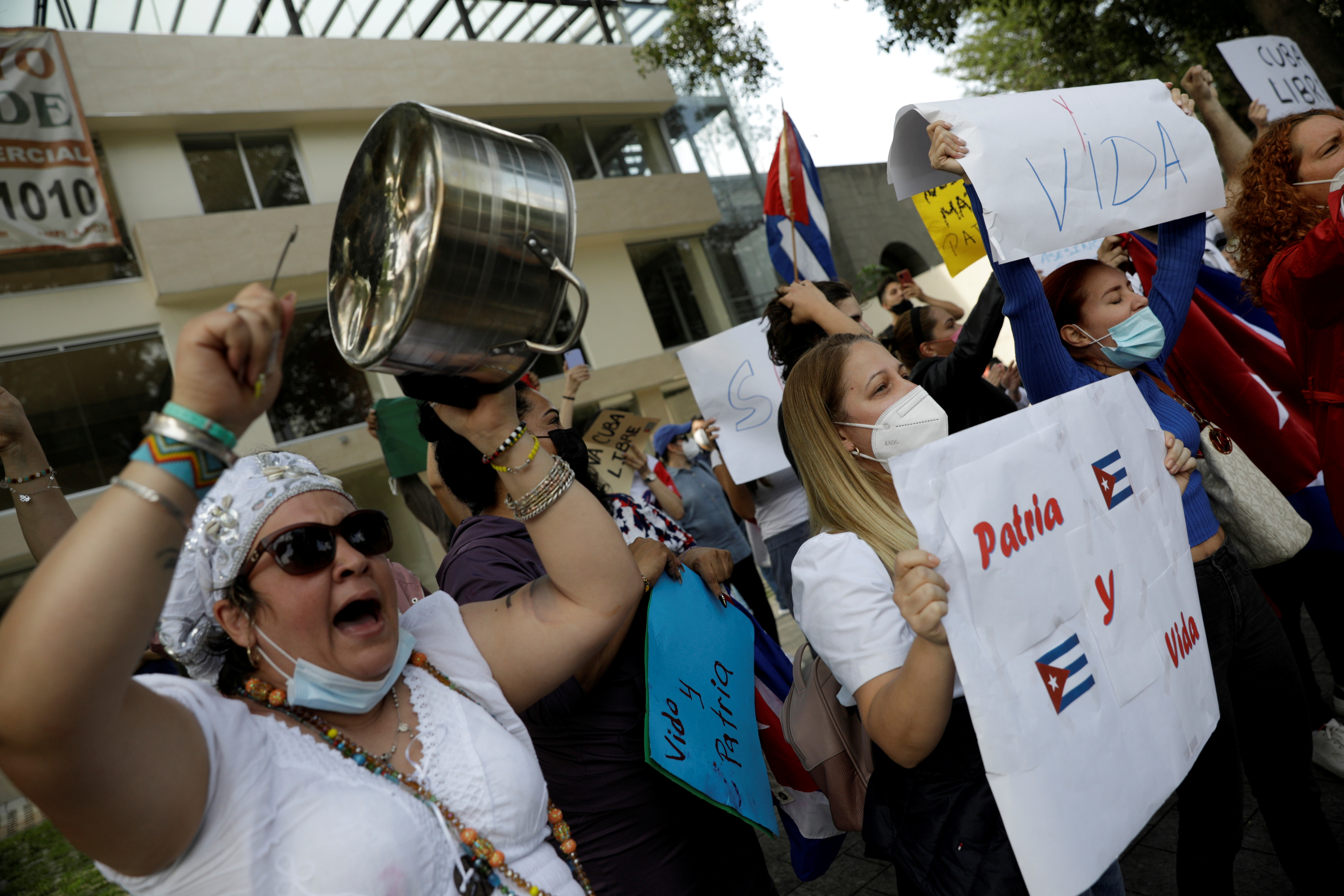Demonstrators hold placards and bang pots during a protest against the Cuban government outside the Cuban Embassy in Mexico City, Mexico July 12, 2021. REUTERS/Luis Cortes/File Photo