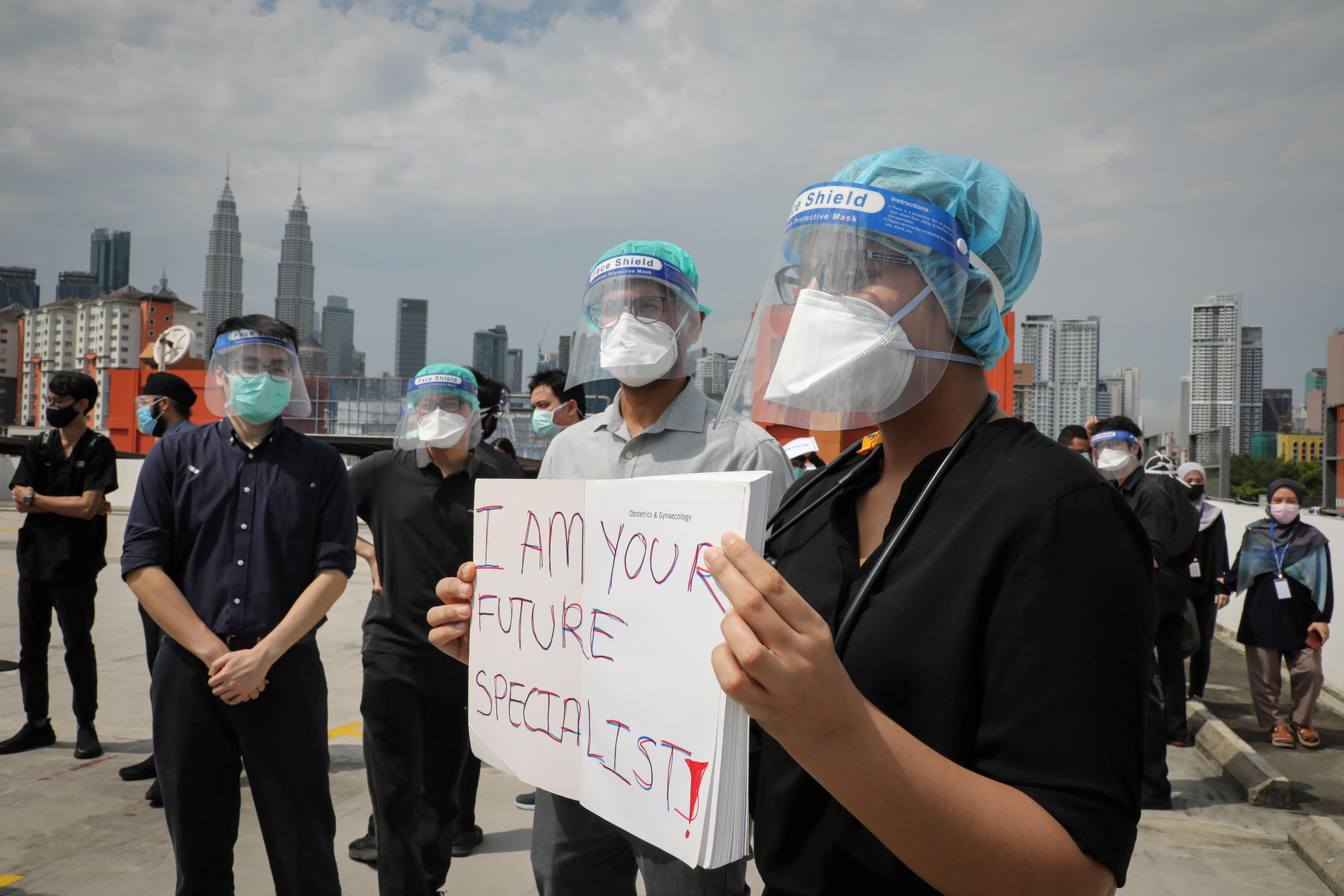Government medical contract doctors participate in a walkout strike at Kuala Lumpur Hospital amid the coronavirus disease (COVID-19) outbreak in Kuala Lumpur, Malaysia July 26, 2021. REUTERS/Lim Huey Teng