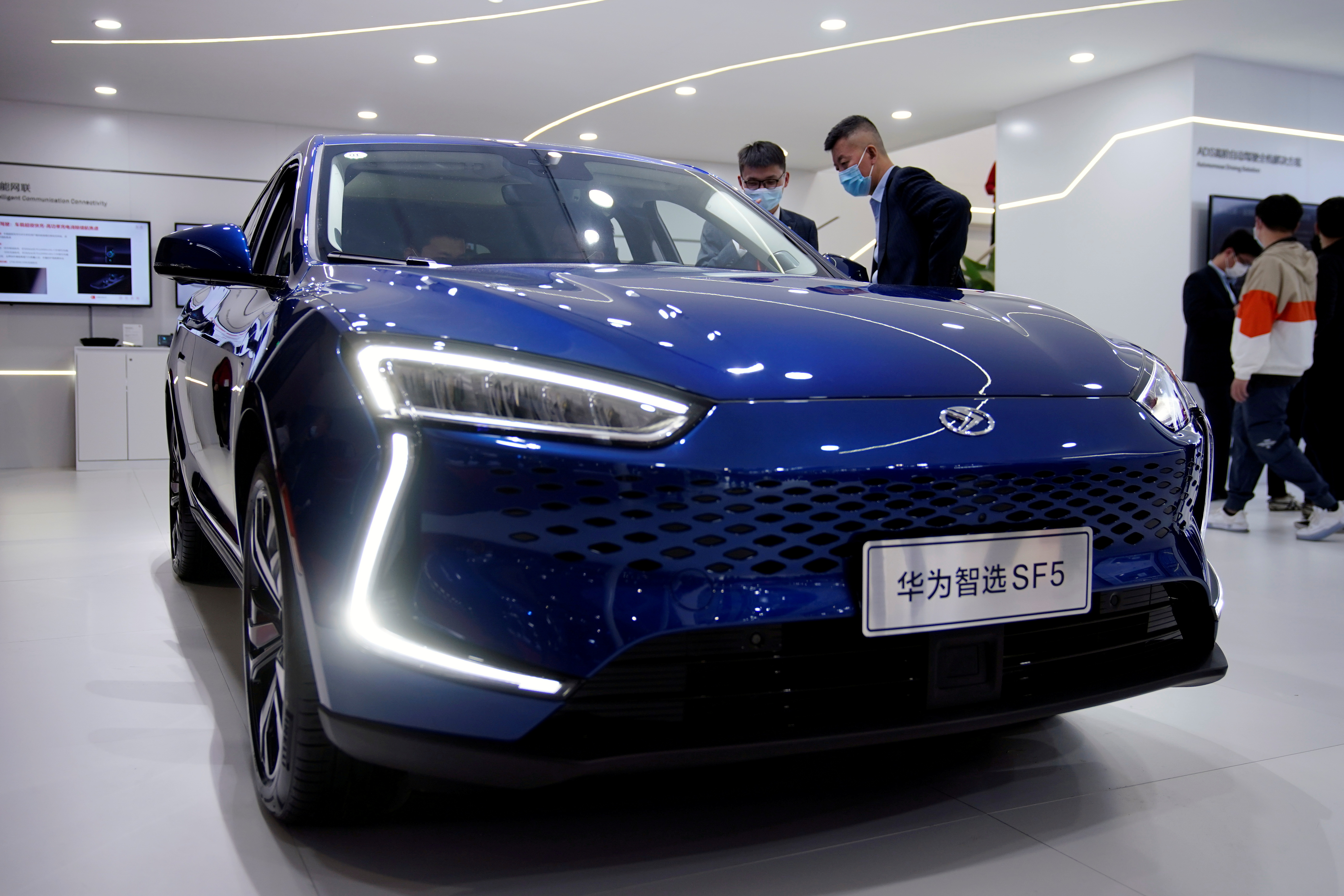 People check a Seres Huawei Smart Selection SF5 electric vehicle (EV) displayed during the Auto Shanghai show in Shanghai, China April 19, 2021. REUTERS/Aly Song