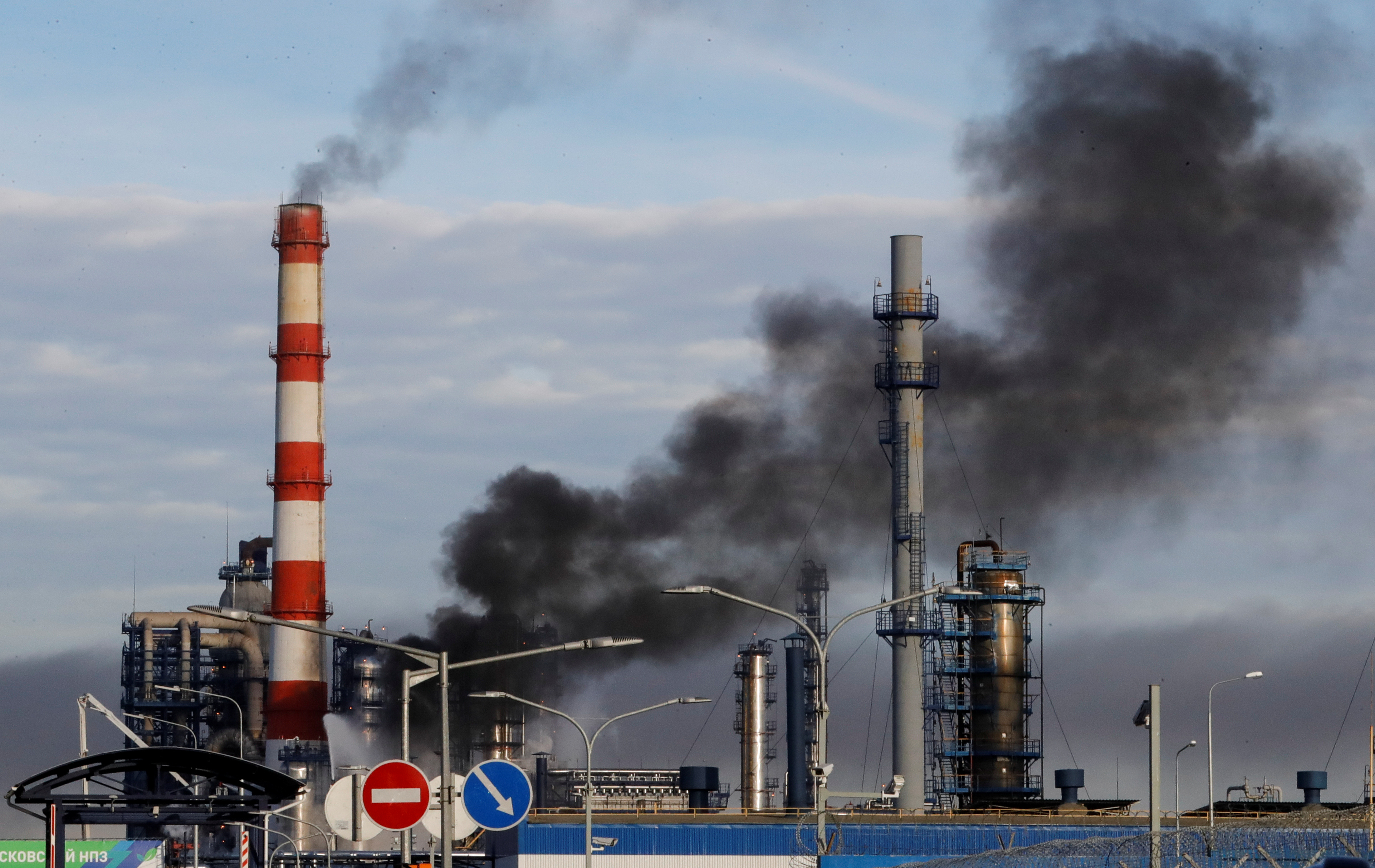 Smoke billows from a fire at oil refinery, owned by Russian oil producer Gazprom Neft, in Moscow, Russia, November 17, 2018.