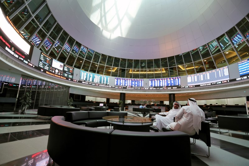 Traders look at the screens at Bahrain Bourse in Manama, Bahrain, February 7, 2018. REUTERS/Hamad I Mohammed