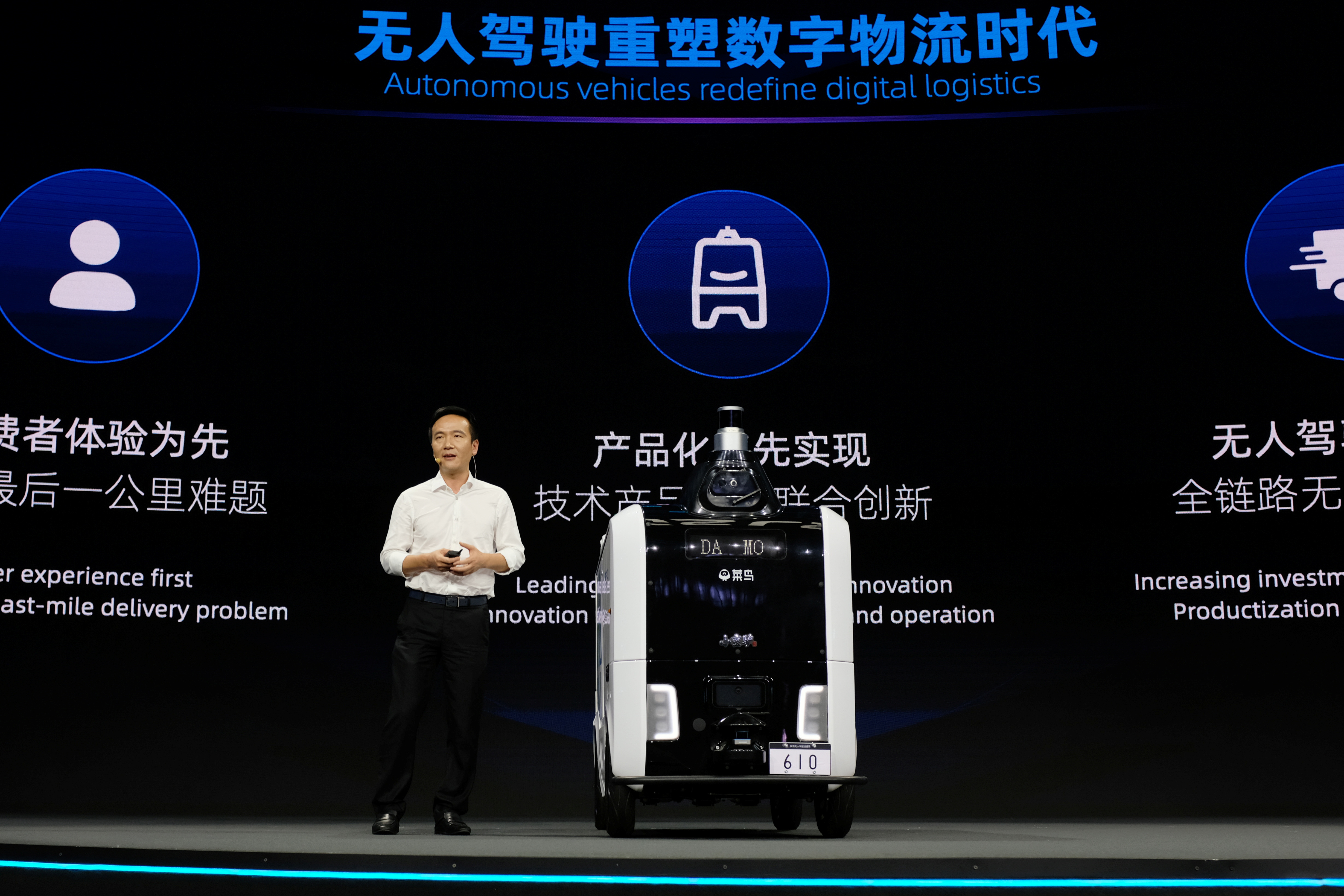 Cheng Li, chief technology officer of Alibaba Group, speaks next to a Cainiao autonomous delivery robot at the Global Smart Logistics Summit organised by Alibaba's logistics arm Cainiao, in Hangzhou, Zhejiang province, China June 10, 2021. REUTERS/Yilei Sun