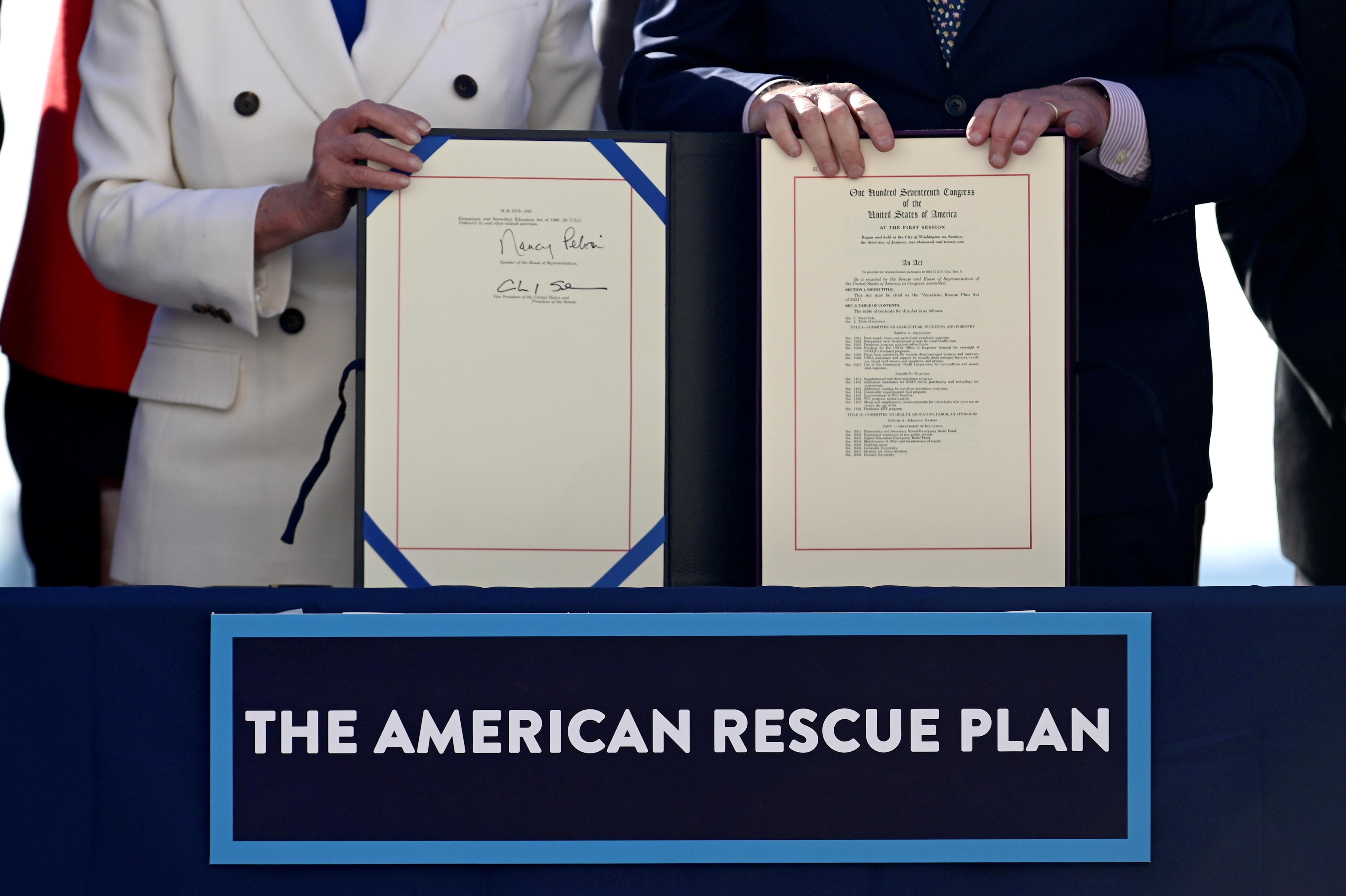 House Speaker Nancy Pelosi (D-CA) and Senate Majority Leader Chuck Schumer display the