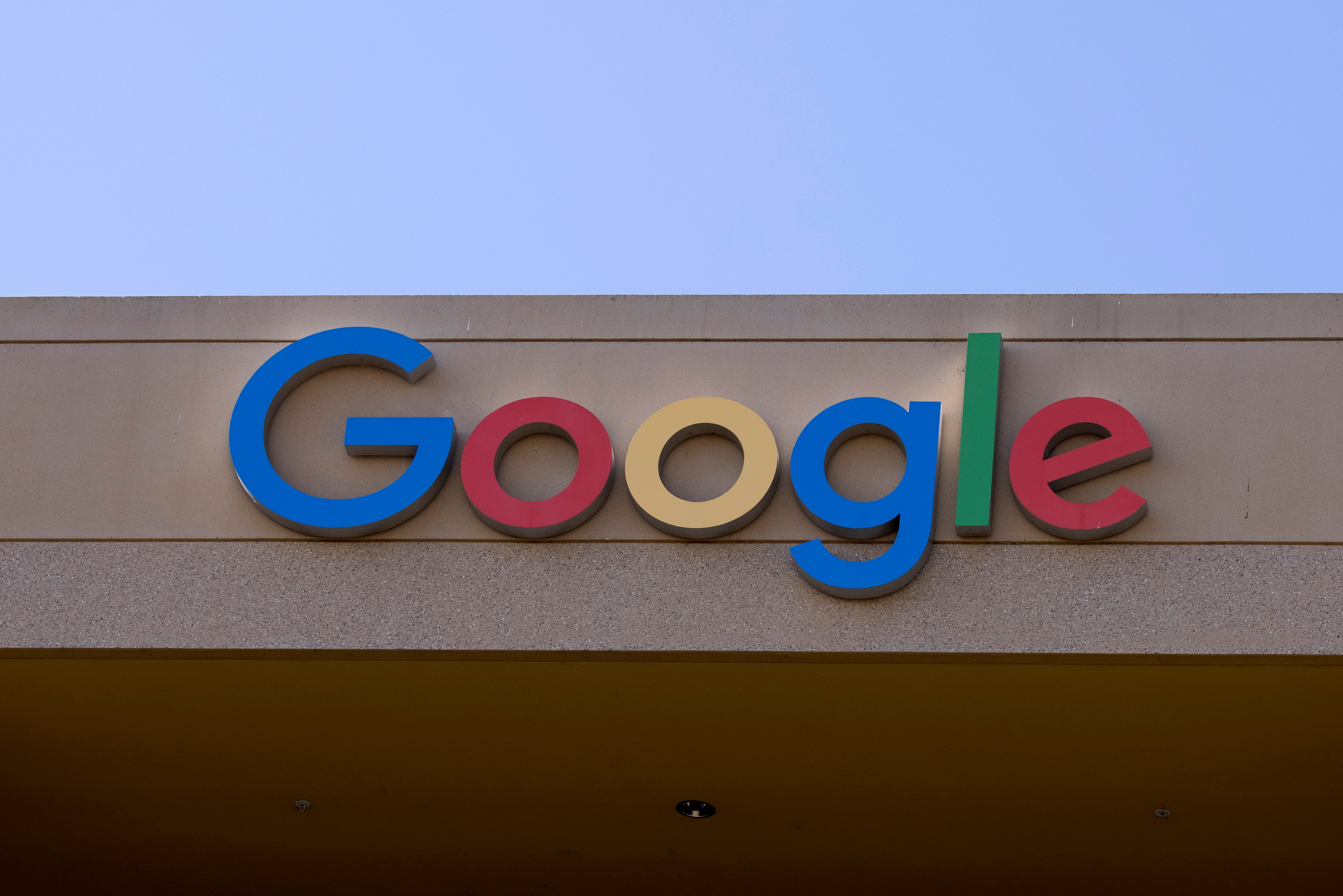The Google sign is shown on one of the company's office buildings in Irvine, California, U.S., October 20, 2020.   REUTERS/Mike Blake/File Photo