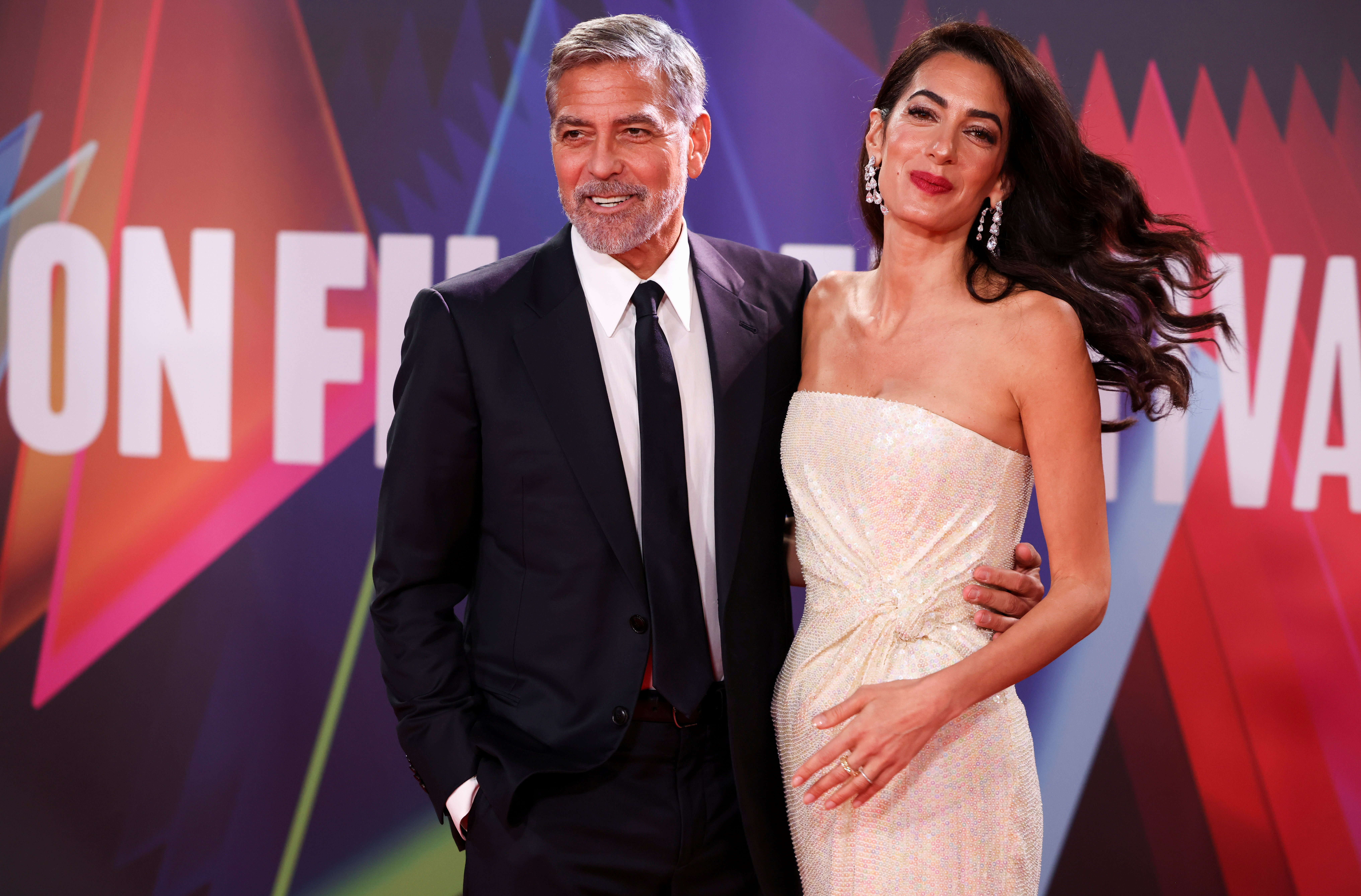 Director George Clooney and his wife lawyer Amal Clooney arrive for a screening of the film