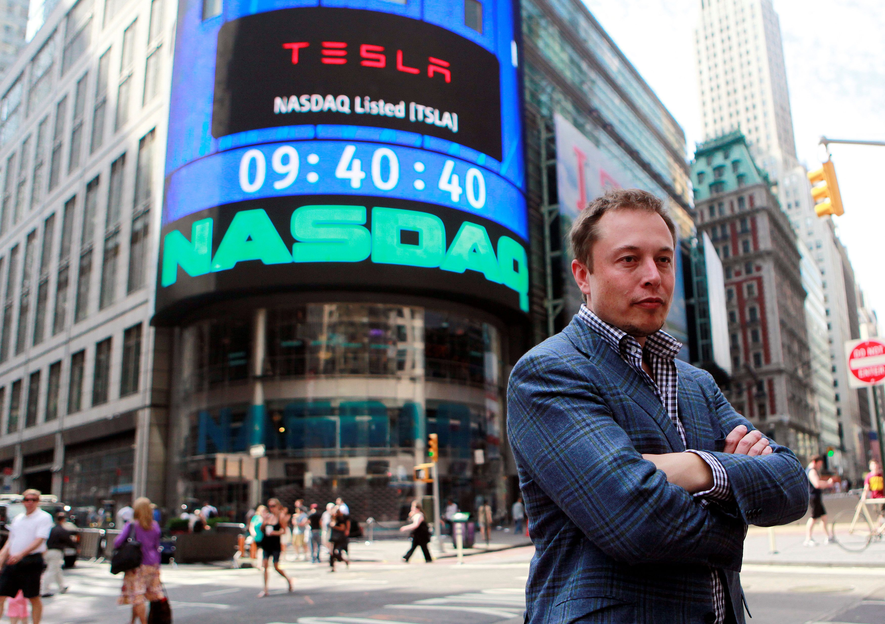 CEO of Tesla Motors Elon Musk poses during a television interview after his company's initial public offering at the NASDAQ market in New York, June 29, 2010. REUTERS/Brendan McDermid