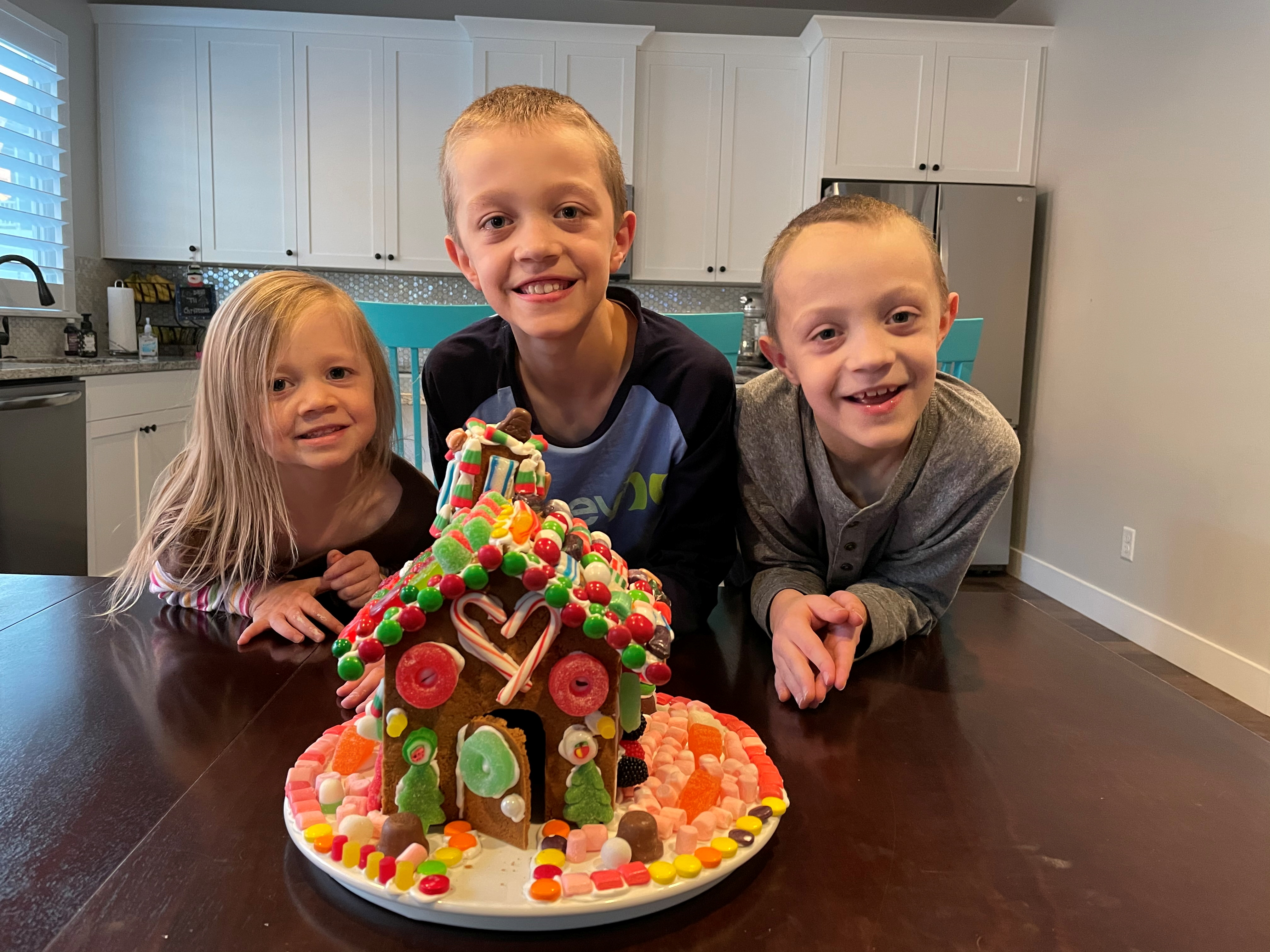 The Sweeten children, Kaden, Jackson and Emily, are seen at their home in Layton, Utah, U.S., in this undated handout photo.  Tristen Sweeten/Handout via REUTERS