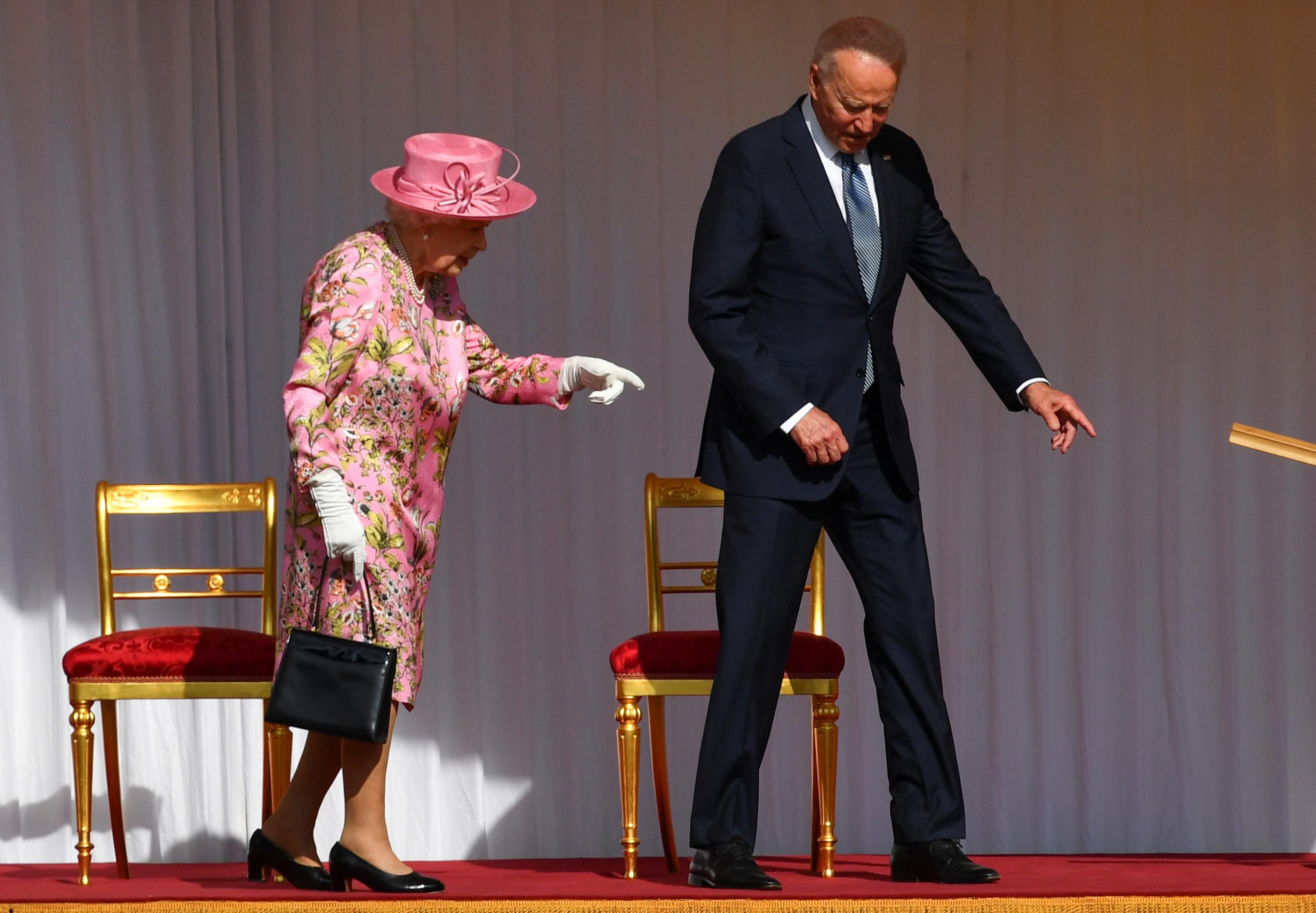 U.S. President Joe Biden walks in front of Britain's Queen Elizabeth, at Windsor Castle in Windsor, Britain, June 13, 2021. REUTERS/Dylan Martinez