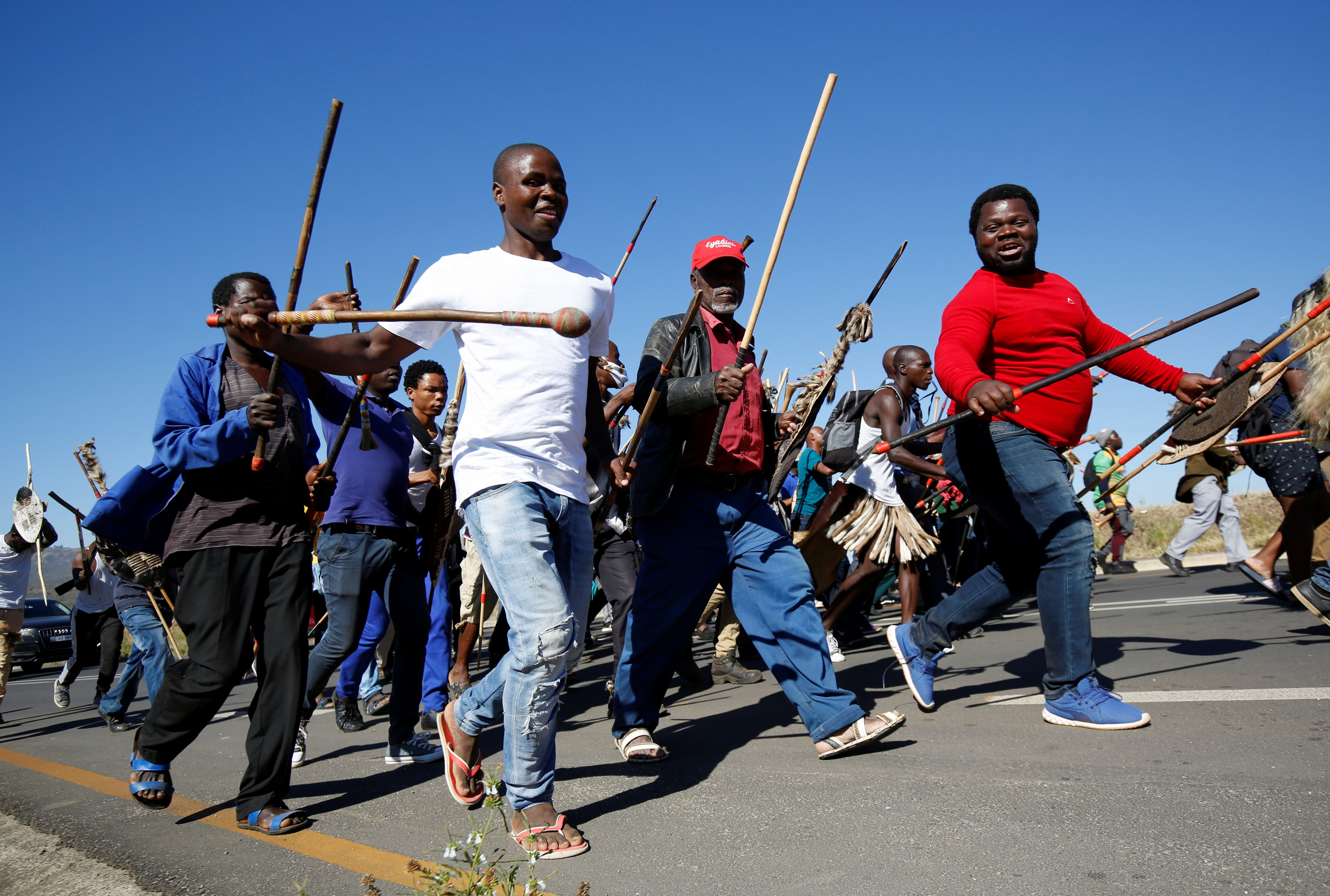 Supporters of former South African President Jacob Zuma, who was sentenced to a 15-month imprisonment by the Constitutional Court, walk to his home in Nkandla, South Africa, July 3, 2021. REUTERS/Rogan Ward