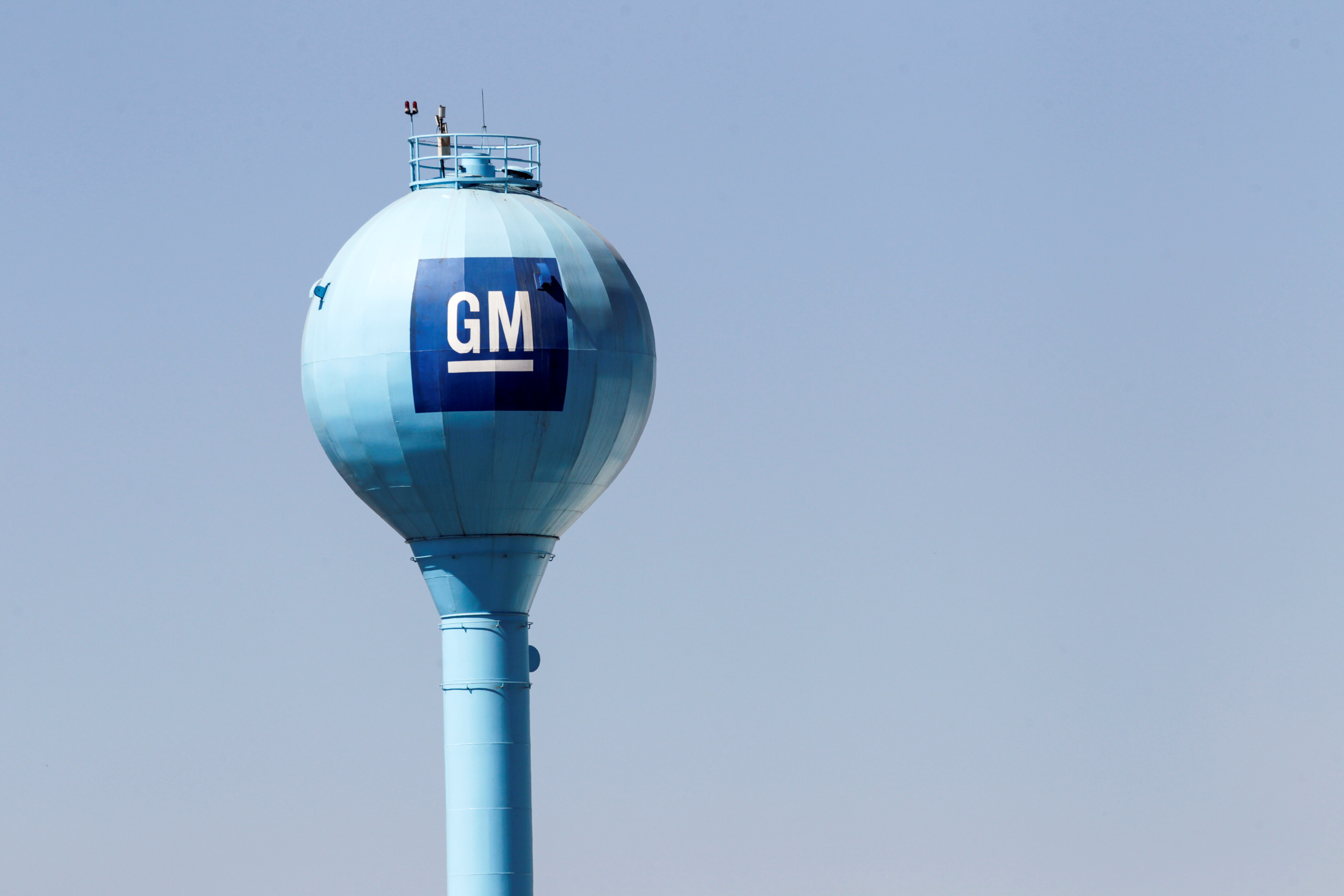 The GM logo is seen on a water tank of the General Motors assembly plant in Ramos Arizpe, in Coahuila state, Mexico February 11, 2021. REUTERS/Daniel Becerril