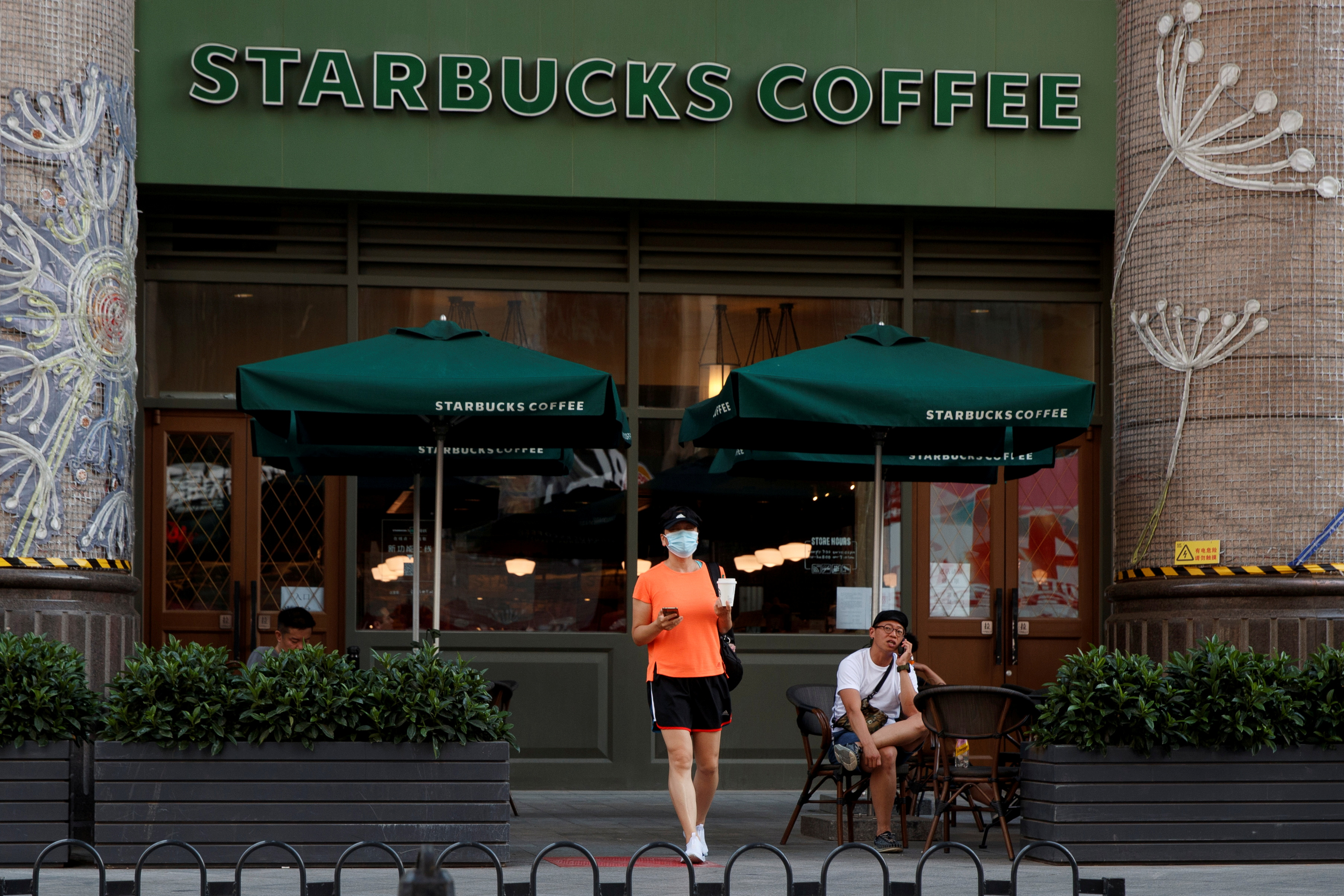 A woman leaves a cafe of Starbucks Coffee in Beijing, China, July 6, 2020.  REUTERS/Thomas Peter
