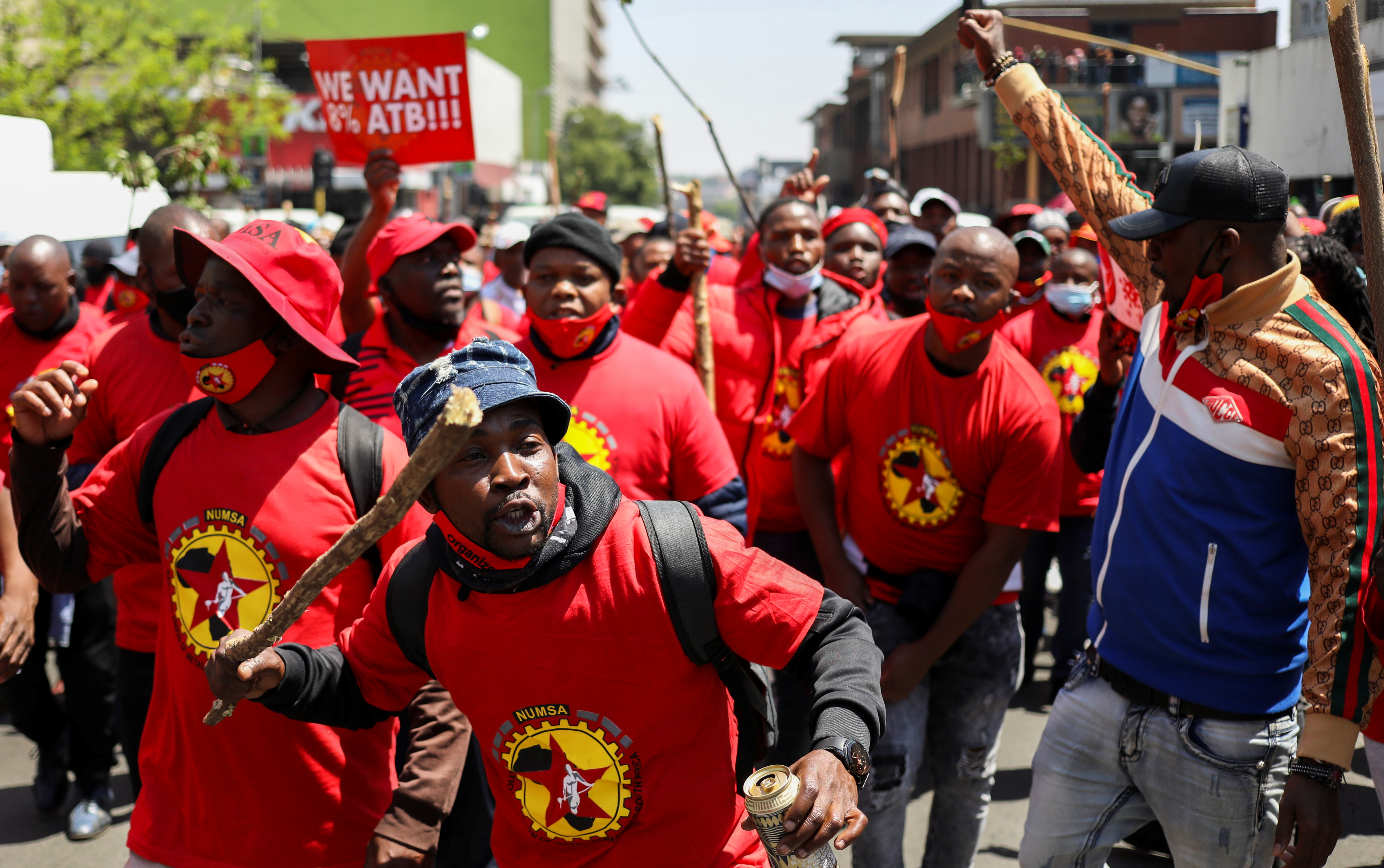 Members of the National Union of Metalworkers of South Africa (NUMSA) march during a strike, threatening to choke supplies of parts to make new cars and accessories, in Johannesburg, South Africa, October 5, 2021. REUTERS/Siphiwe Sibeko