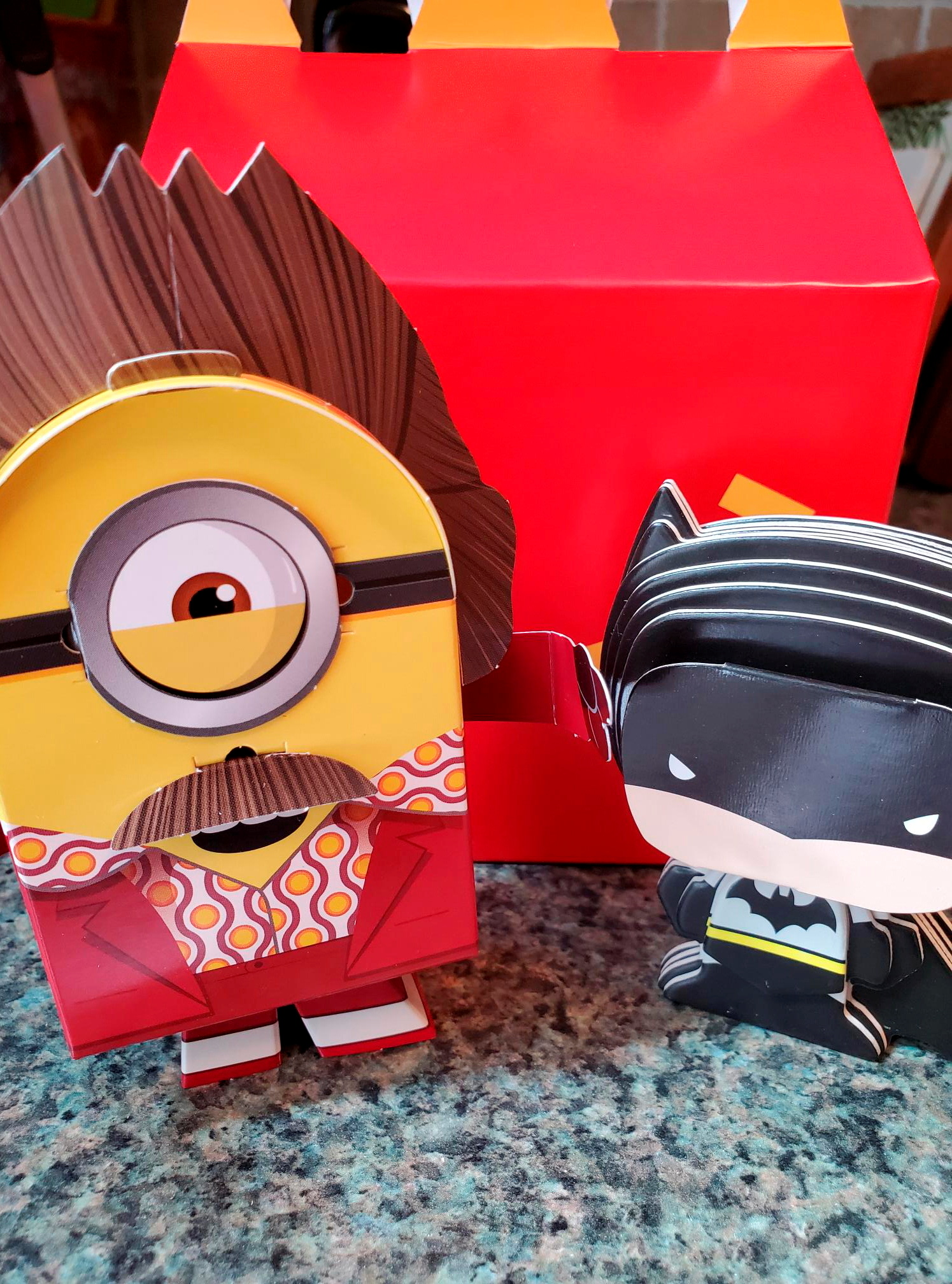 Batman and Minions toys made from paper and cardboard that children assemble themselves are seen, as McDonald's makes its future Happy Meal toys for kids more sustainable, in New York, U.S. September 20, 2021. REUTERS/Hilary Russ