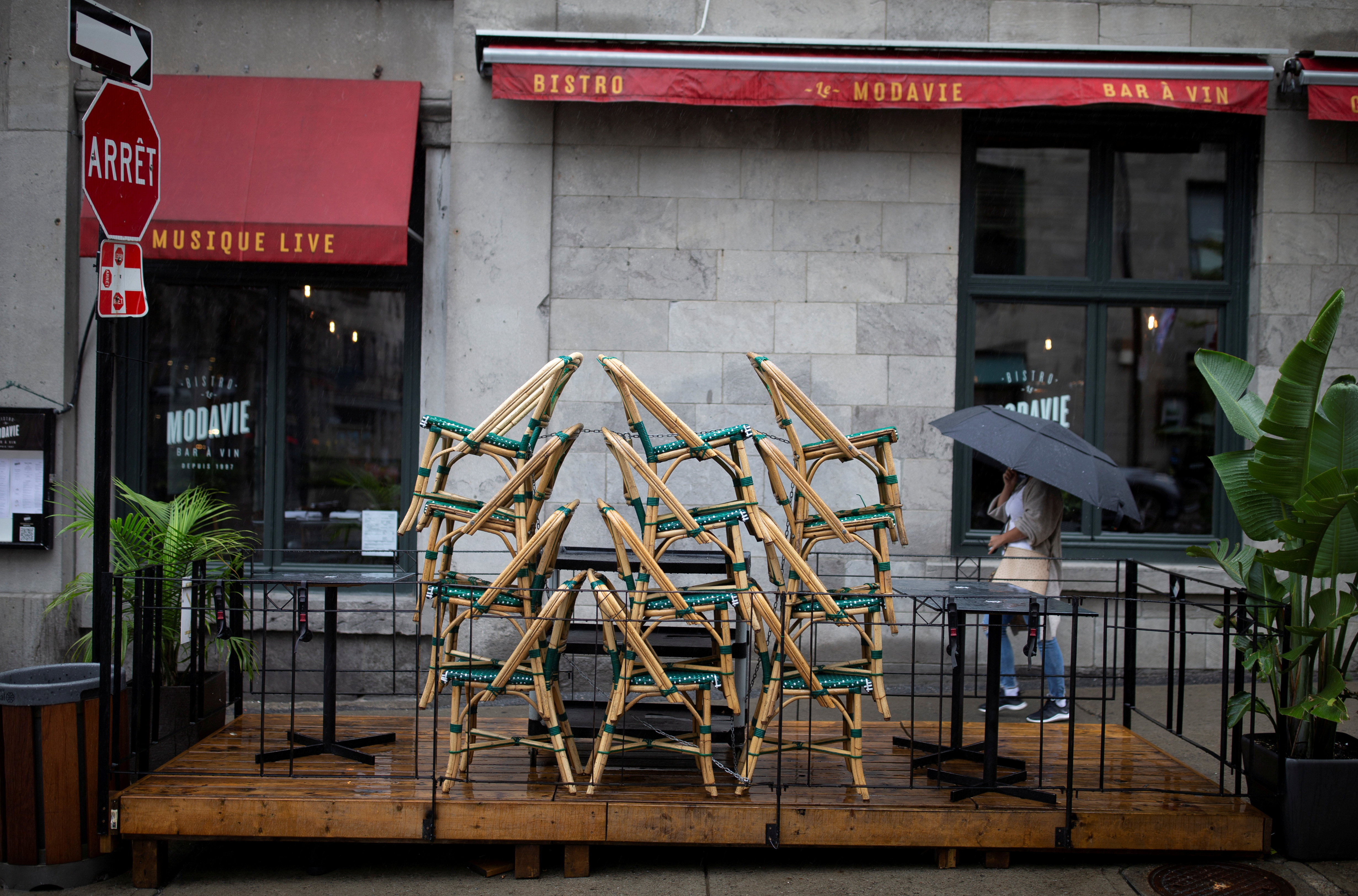 Chairs are stacked outside a bistro in Montreal, Quebec, Canada September 29, 2020. REUTERS/Christinne Muschi