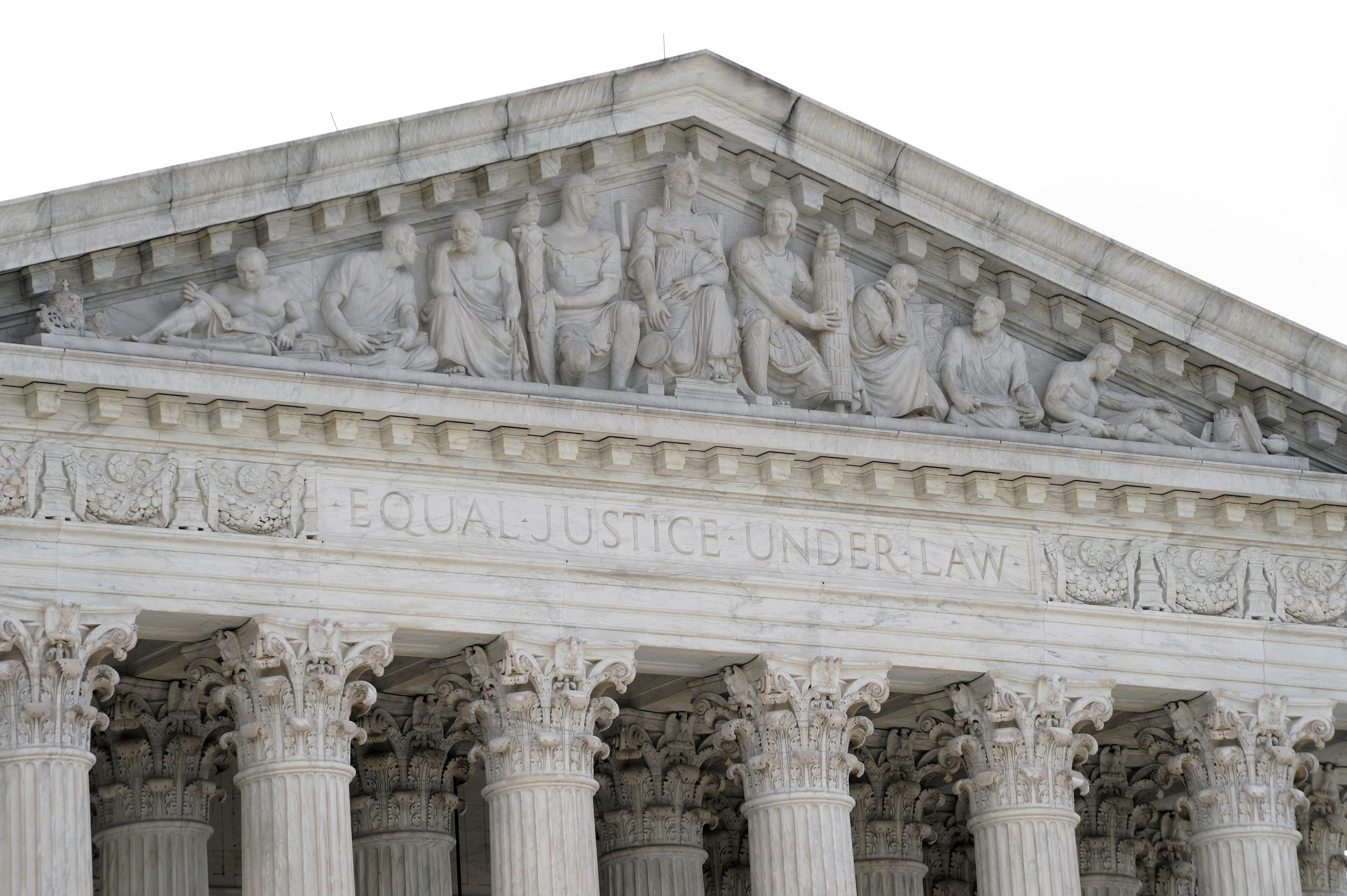 A view shows the pediment of the U.S. Supreme Court building in Washington, D.C., U.S. June 25, 2021. REUTERS/Ken Cedeno/File Photo