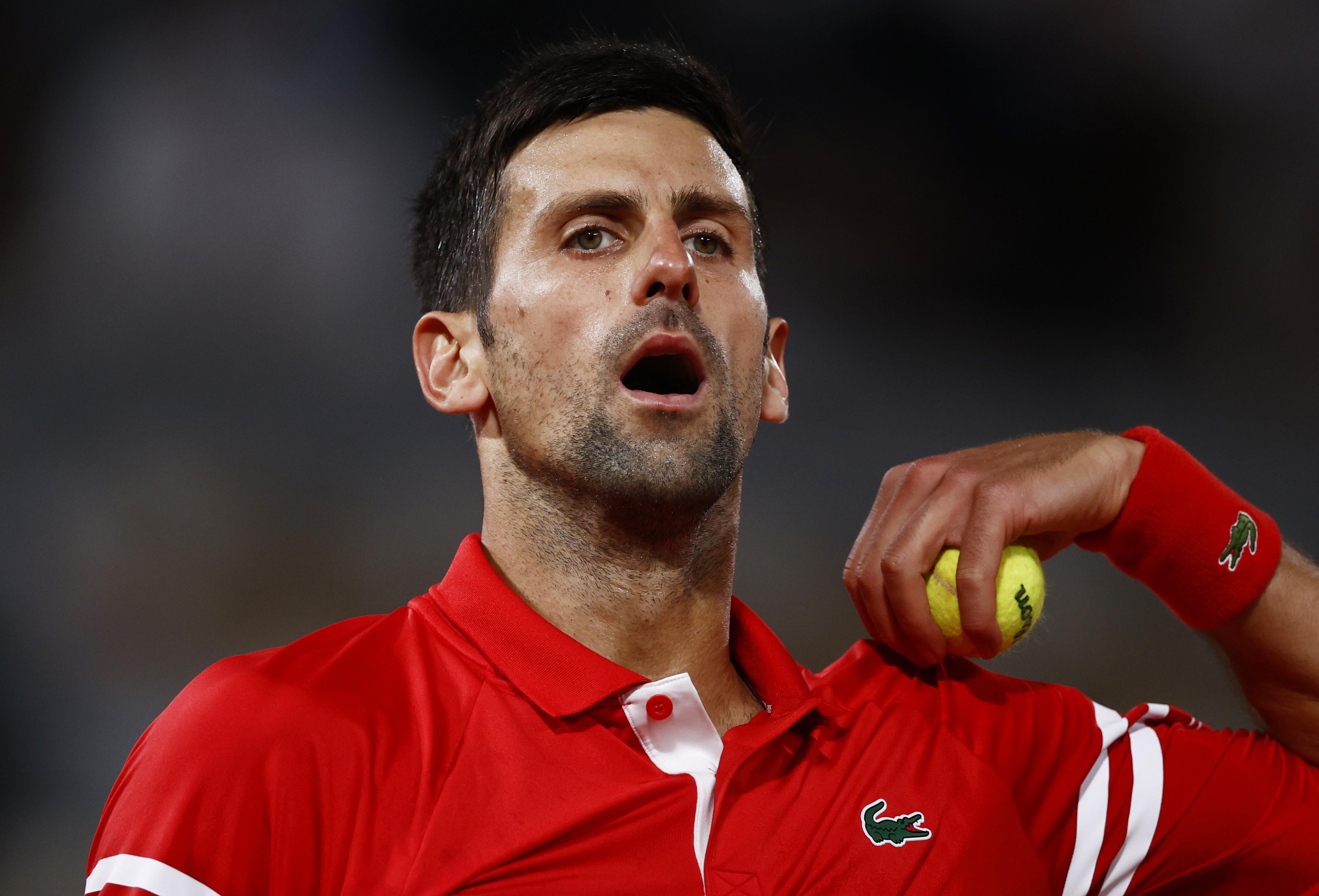 Tennis - French Open - Roland Garros, Paris, France - June 9, 2021  Serbia's Novak Djokovic reacts during his quarter final match against Italy's Matteo Berrettini REUTERS/Christian Hartmann