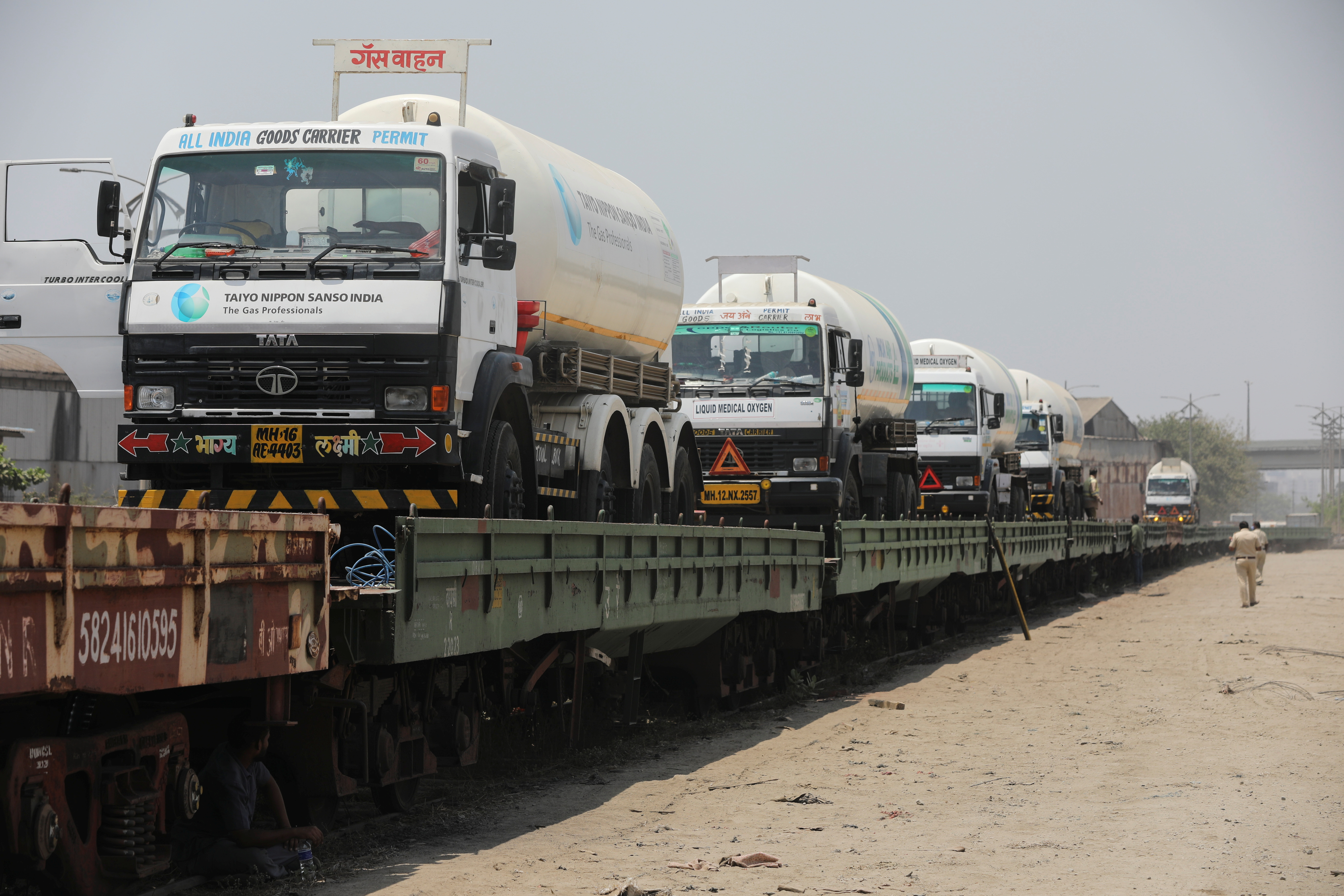 Empty cryogenic tankers are seen onboard the bogie open military new (BOMN) wagon before being transported to a Liquid Medical Oxygen (LMO) plant from another state for refilling with liquid oxygen, amidst the spread of the coronavirus disease (COVID-19), on the outskirts of Mumbai, India, April 19, 2021. REUTERS/Francis Mascarenhas