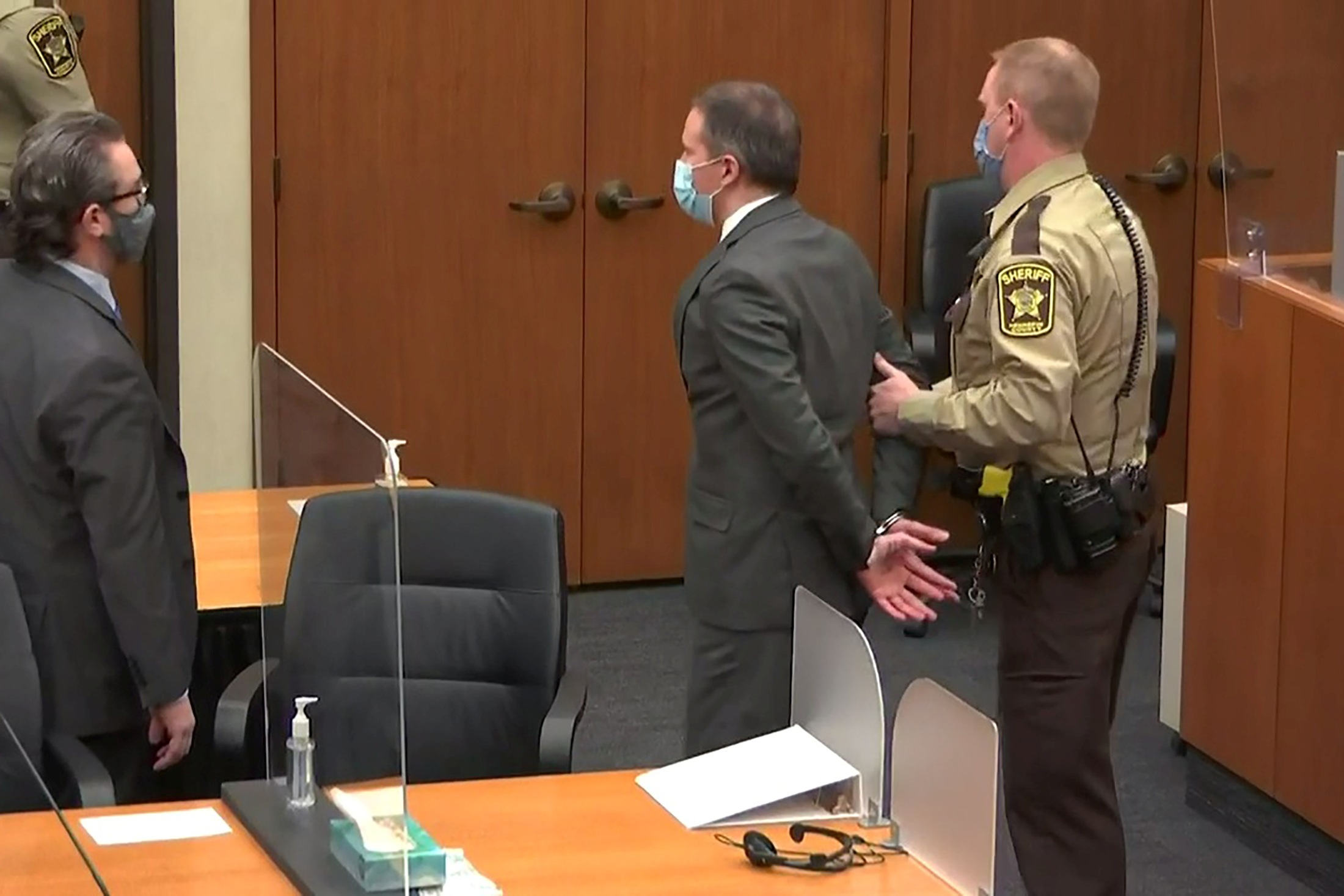 Former Minneapolis police officer Derek Chauvin is led away in handcuffs after a jury found him guilty of all charges in his trial for second-degree murder, third-degree murder and second-degree manslaughter in the death of George Floyd in Minneapolis, Minnesota, U.S. April 20, 2021 in a still image from video.  Pool via REUTERS