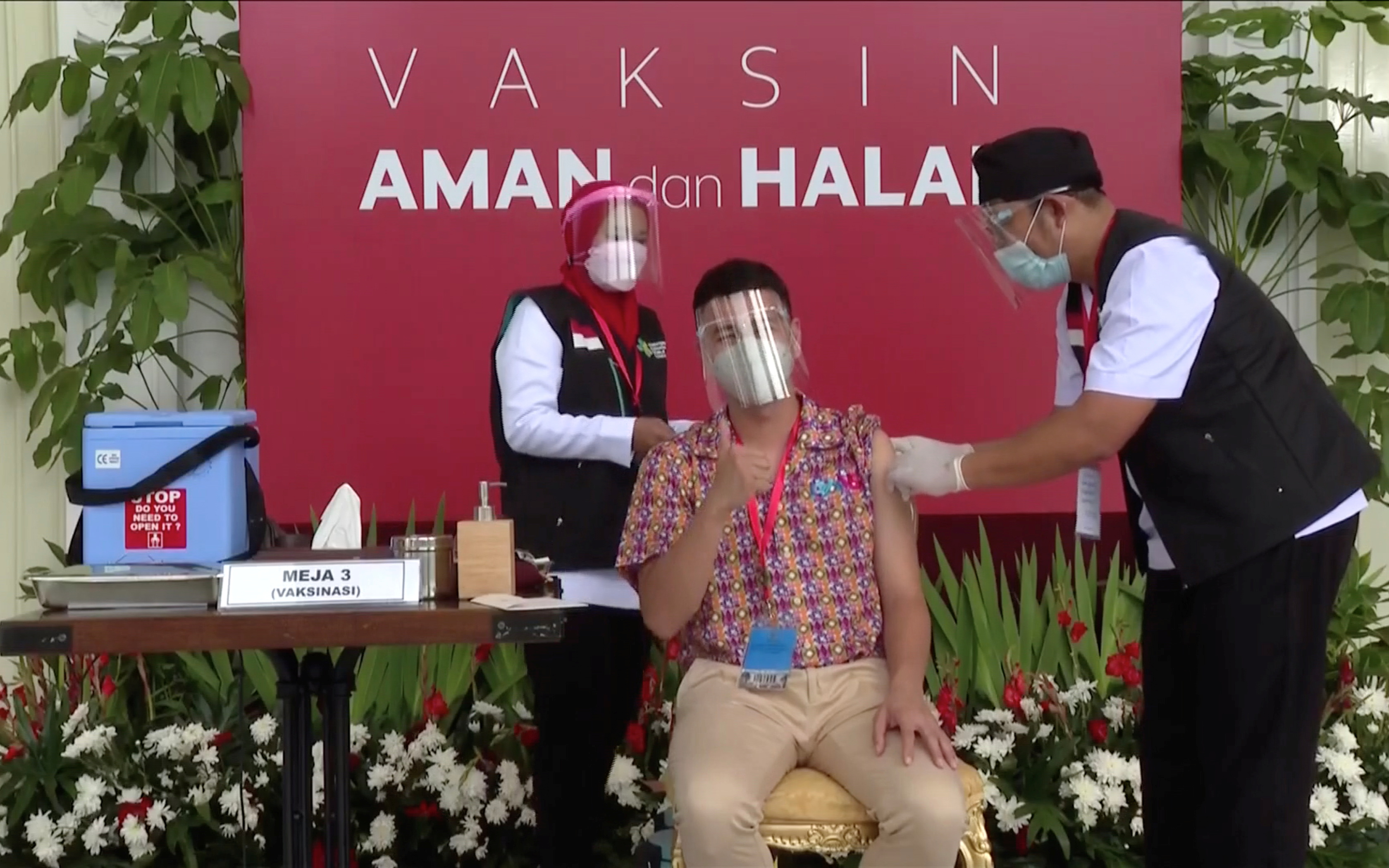 Indonesian influencer Raffi Ahmad receives a shot of the coronavirus disease (COVID-19) vaccine at the Merdeka Palace in Jakarta, Indonesia in a screen grab from January 13, 2021 handout video from Indonesian Presidential Palace via REUTERS.