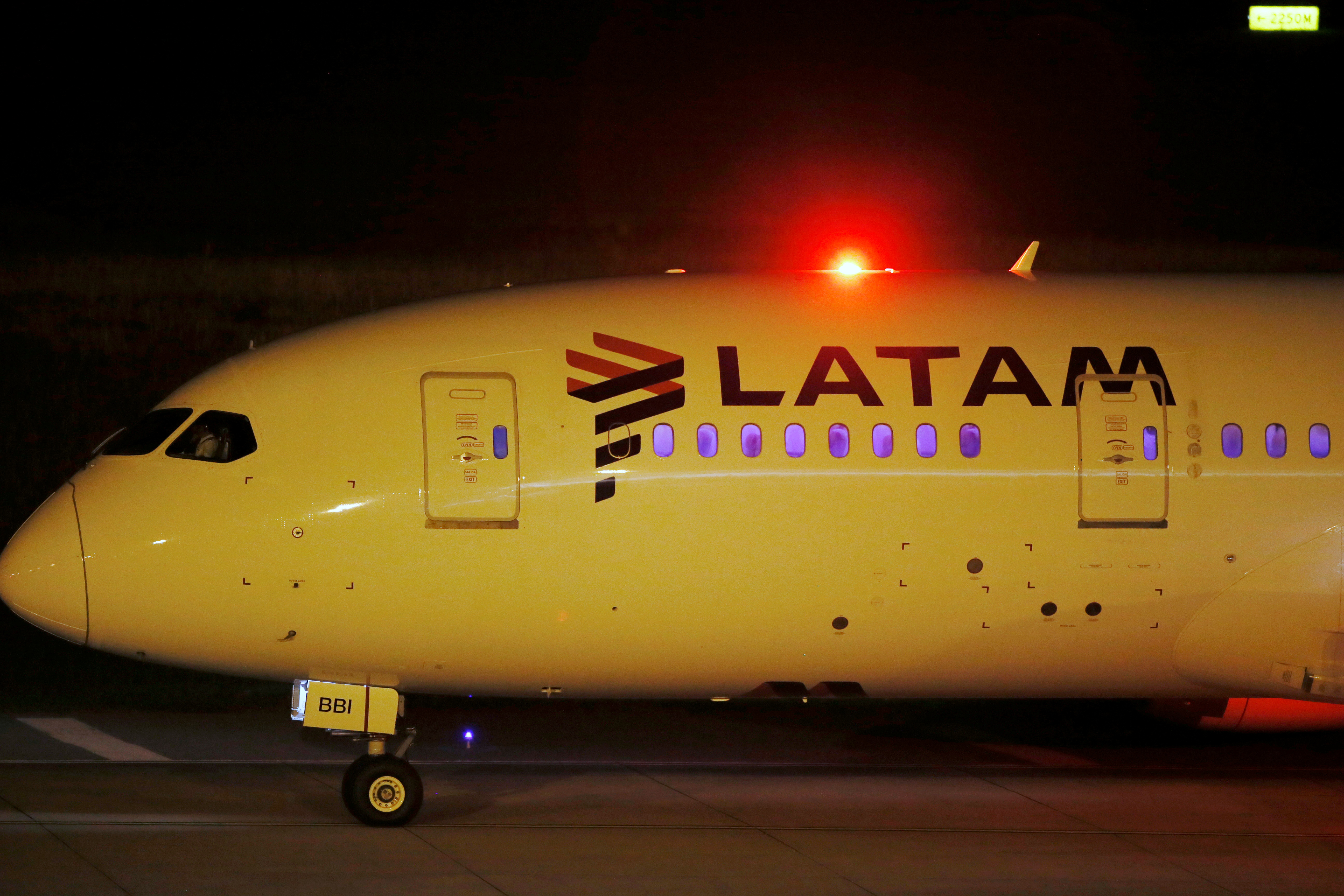 A LATAM Airlines plane carrying a shipment of the Sinovac coronavirus disease (COVID-19) vaccine arrives at Carrasco Airport in Montevideo, Uruguay February 25, 2021. REUTERS/Mariana Greif
