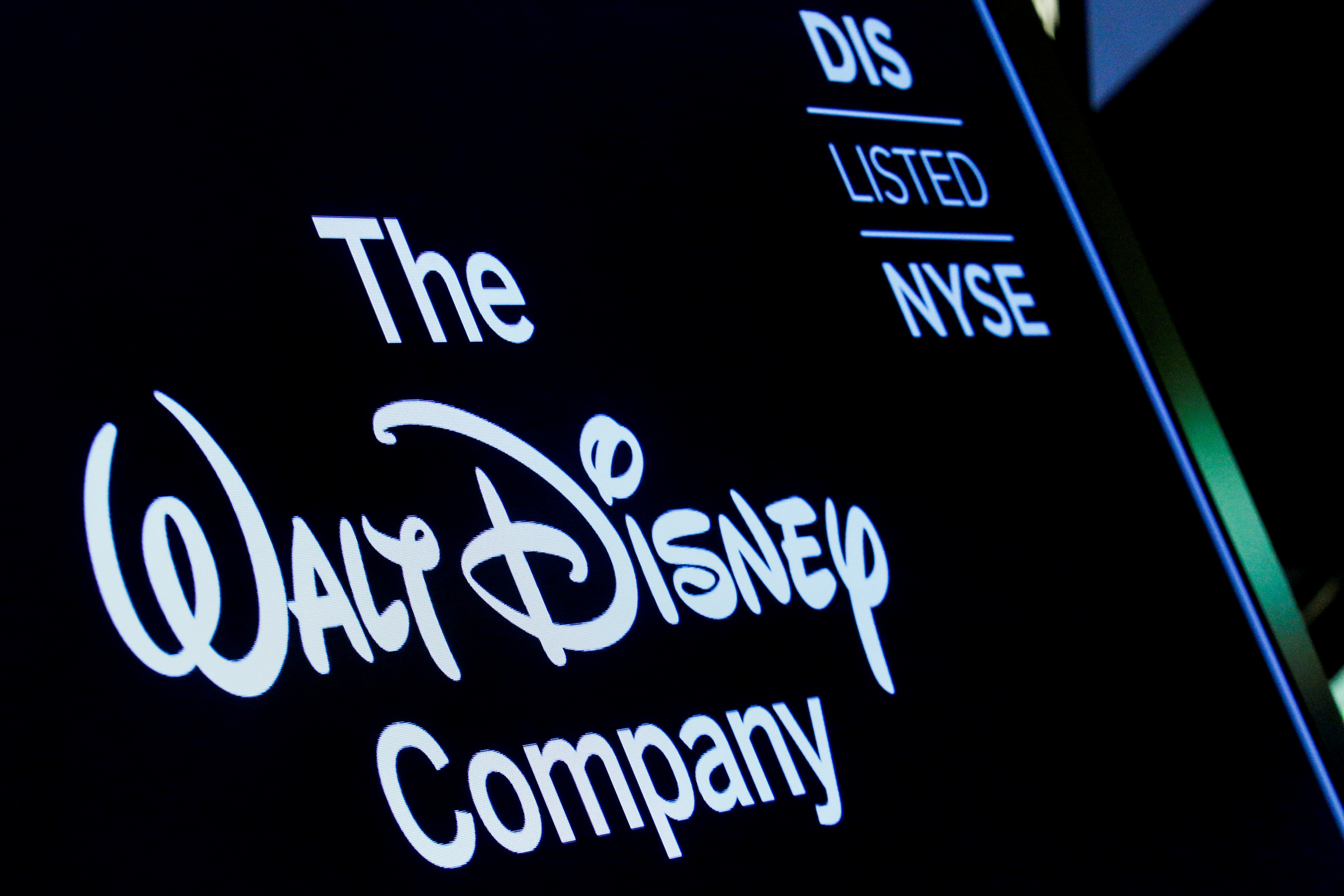 A screen shows the logo and a ticker symbol for The Walt Disney Company on the floor of the New York Stock Exchange (NYSE) in New York, U.S., December 14, 2017. REUTERS/Brendan McDermid/File Photo