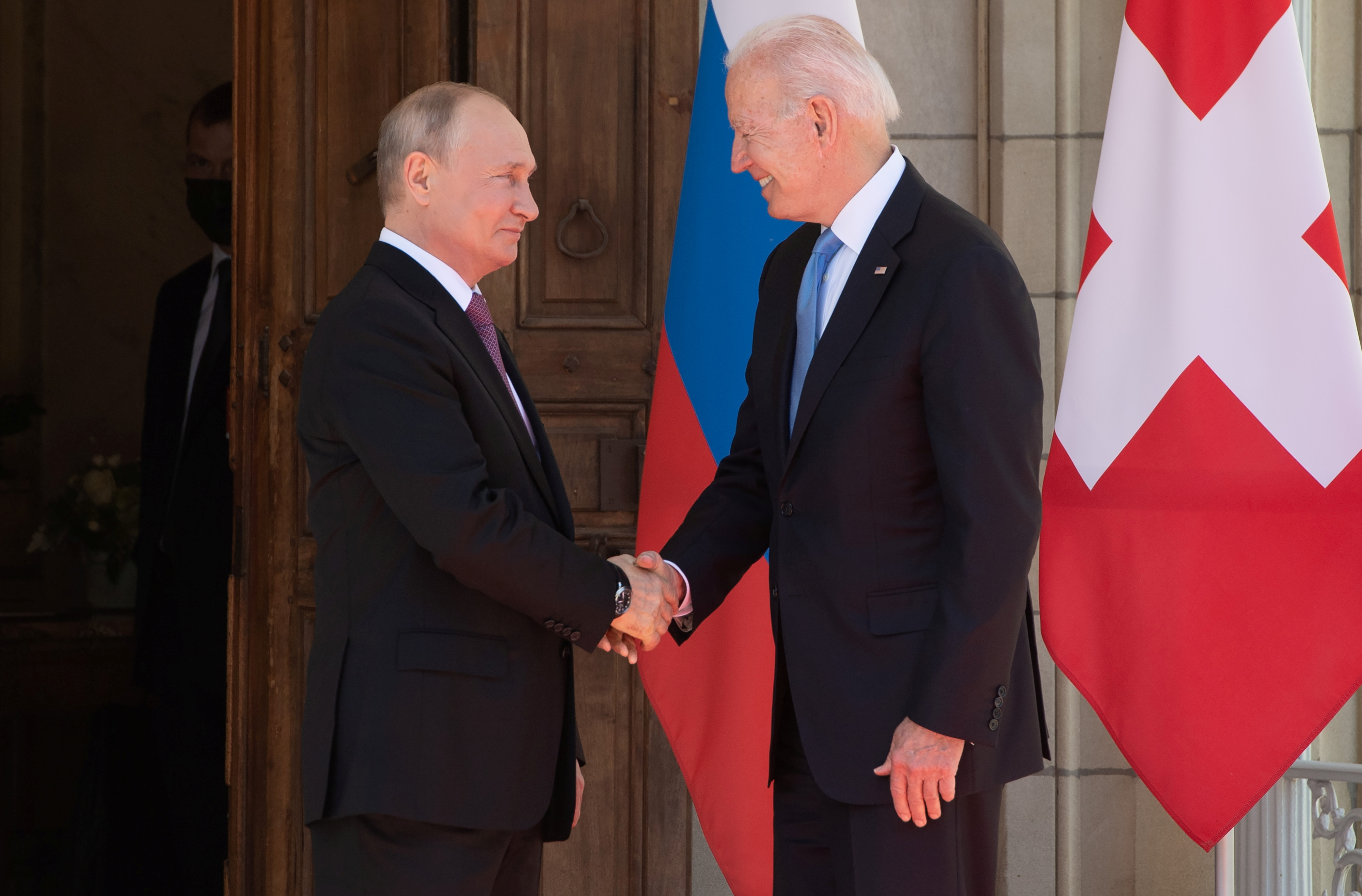 U.S. President Joe Biden and Russia's President Vladimir Putin shake hands as they arrive for the U.S.-Russia summit at Villa La Grange in Geneva, Switzerland June 16, 2021. Saul Loeb/Pool via REUTERS