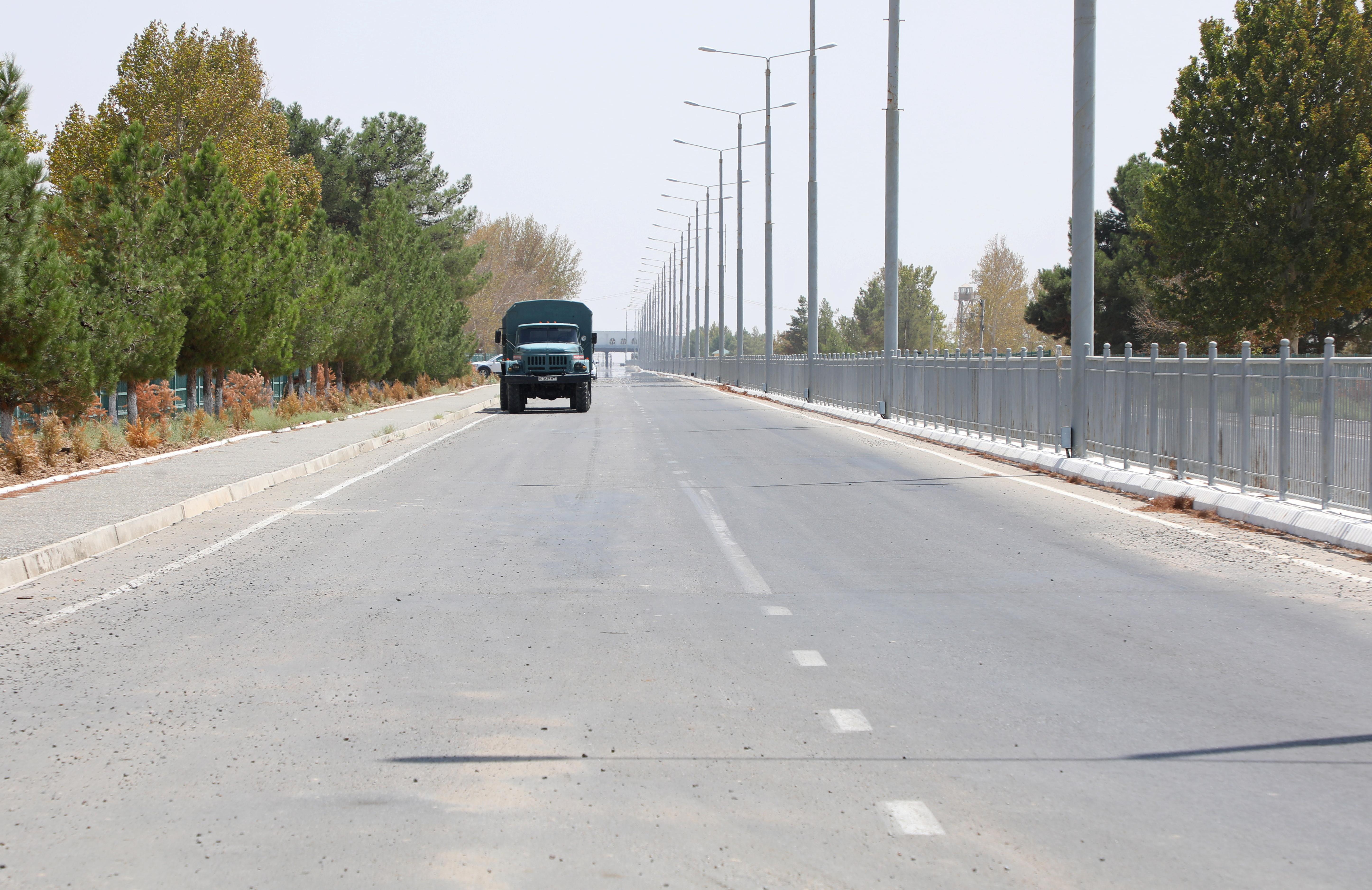 A vehicle drives near a checkpoint at the Uzbekistan-Afghanistan border in Ayritom, Uzbekistan August 15, 2021. REUTERS/Abror Kurbonmuratov