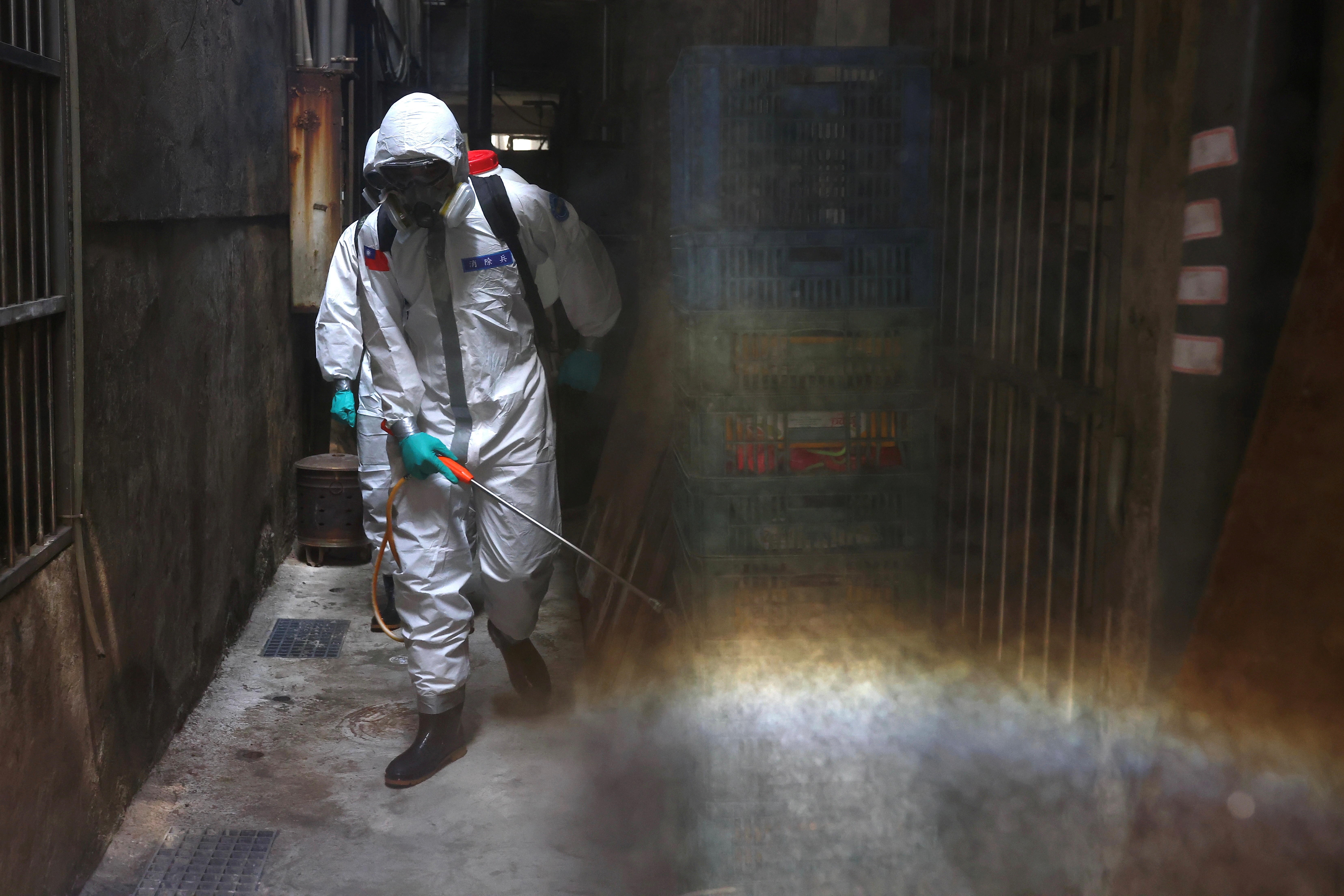 Soldiers in protective suits disinfect a street following the recent surge of coronavirus disease (COVID-19) infections, in the Tucheng district of New Taipei City, Taiwan May 27, 2021. REUTERS/Ann Wang