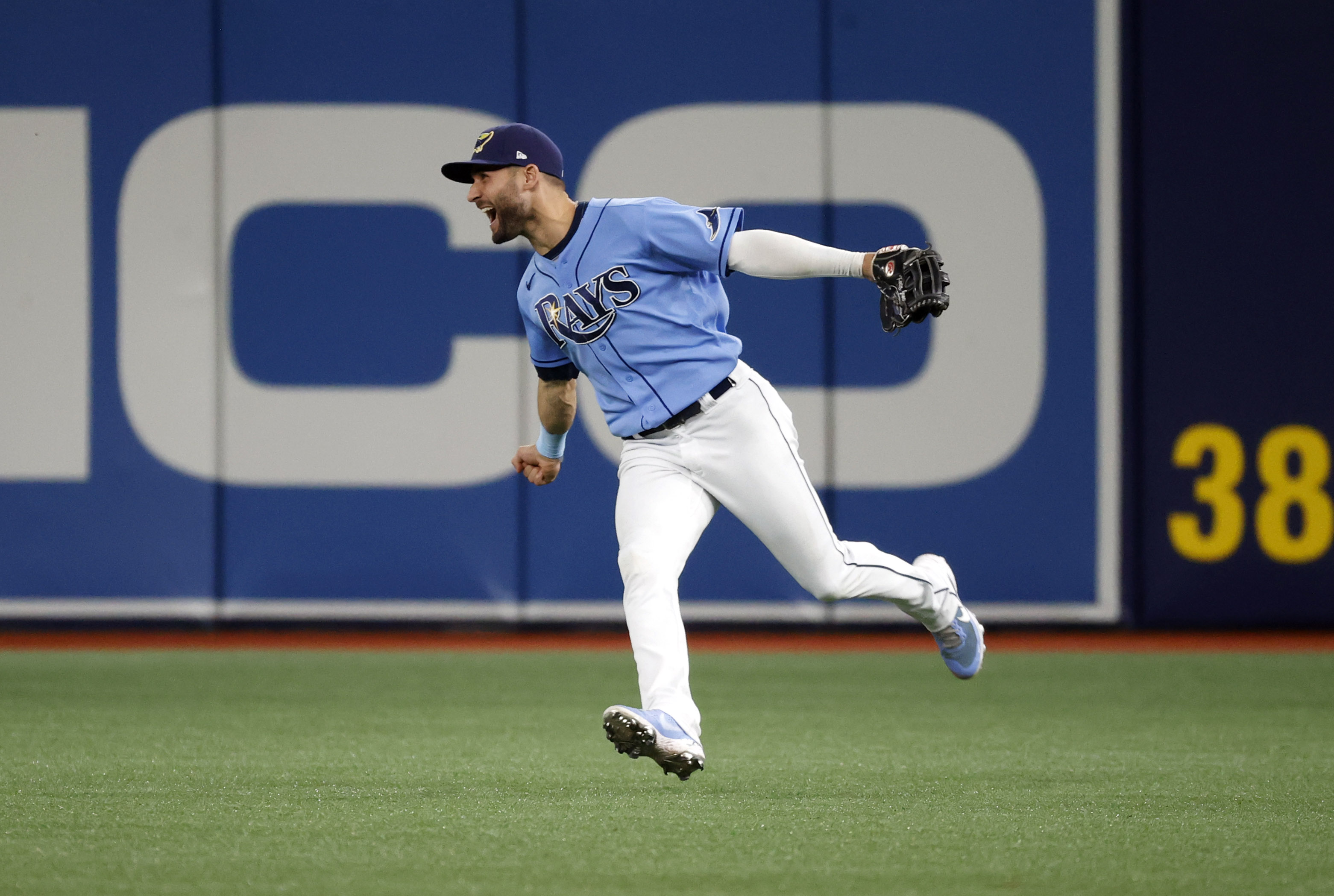 Aug 1, 2021; St. Petersburg, Florida, USA;Tampa Bay Rays center fielder Kevin Kiermaier (39) celebrates after defeating the Boston Red Sox at Tropicana Field. Mandatory Credit: Kim Klement-USA TODAY Sports