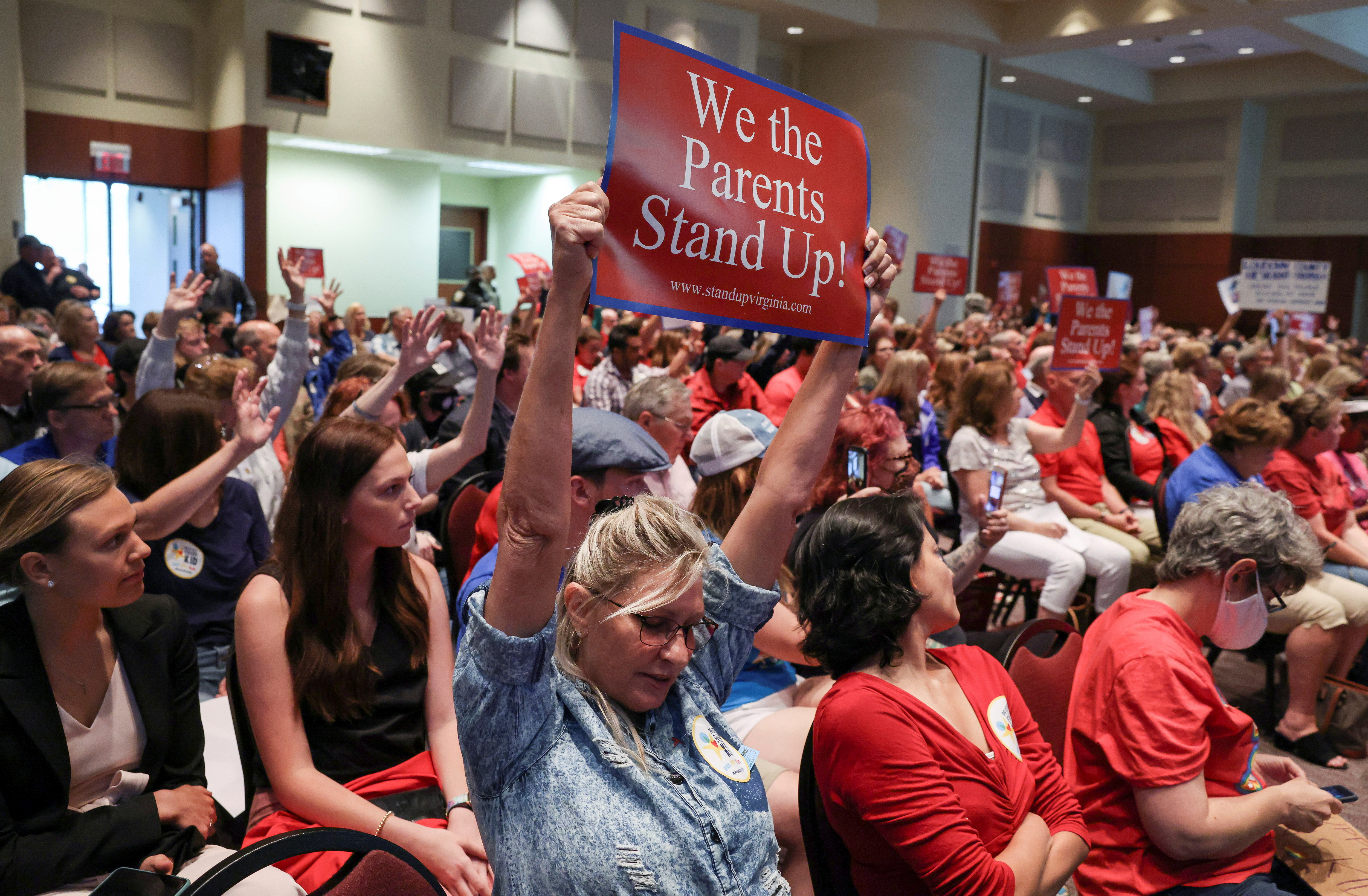 Parents and community members attend a Loudoun County School Board meeting which included a discussion about the academic doctrine known as Critical Race Theory, in Ashburn, Virginia, U.S.  June 22, 2021. REUTERS/Evelyn Hockstein/File Photo