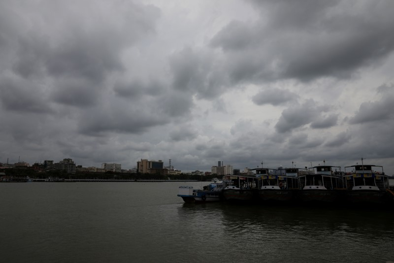 Clouds cover the skies over the river Ganges ahead of Cyclone Amphan, in Kolkata, India, May 19, 2020. REUTERS/Rupak De Chowdhuri/File Photo