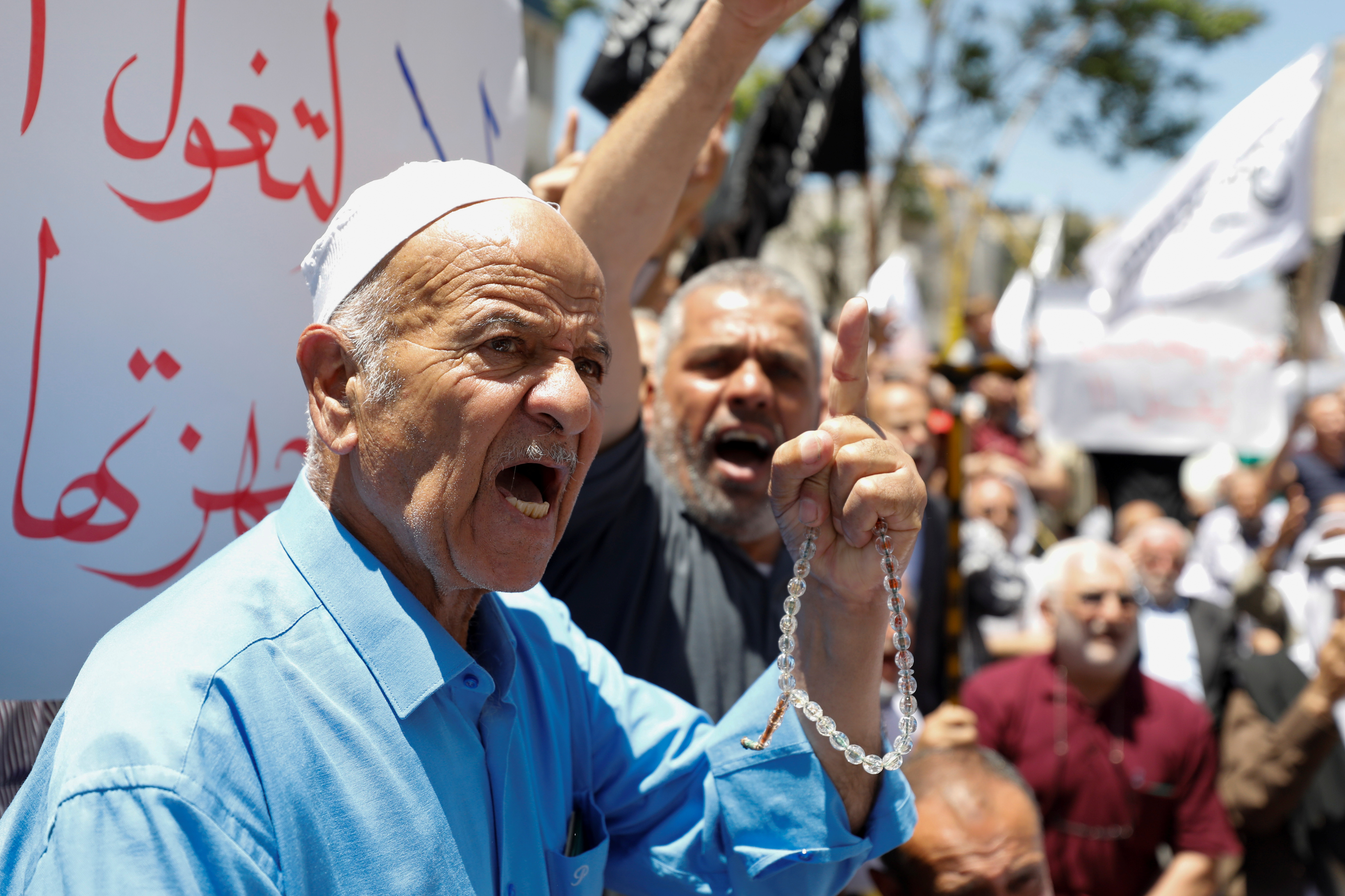 People take part in a protest over the death of Nizar Banat, a critic of the Palestinian Authority, in Hebron, in the Israeli-occupied West Bank, June 26, 2021. REUTERS/Mussa Qawasma