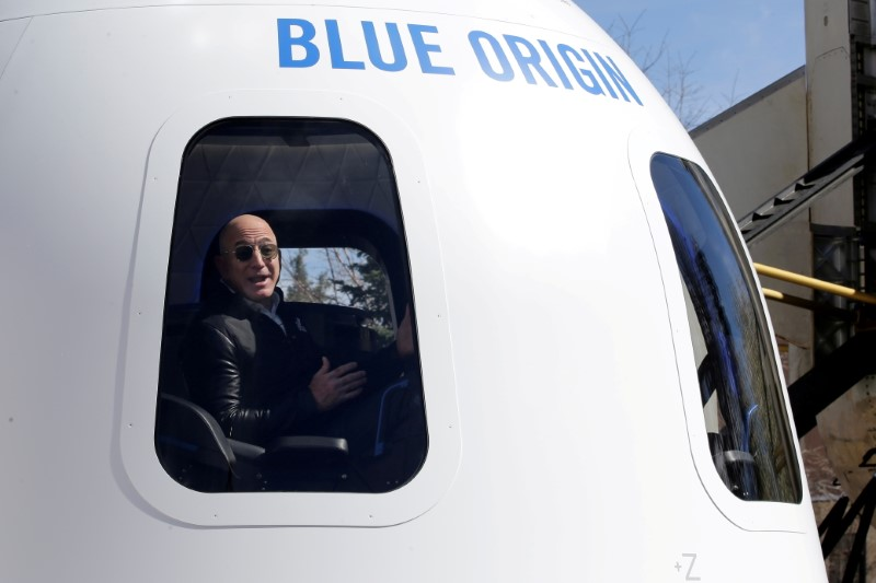 Amazon and Blue Origin founder Jeff Bezos addresses the media about the New Shepard rocket booster and Crew Capsule mockup at the 33rd Space Symposium in Colorado Springs, Colorado, United States April 5, 2017.  REUTERS/Isaiah J. Downing/File Photo/File Photo