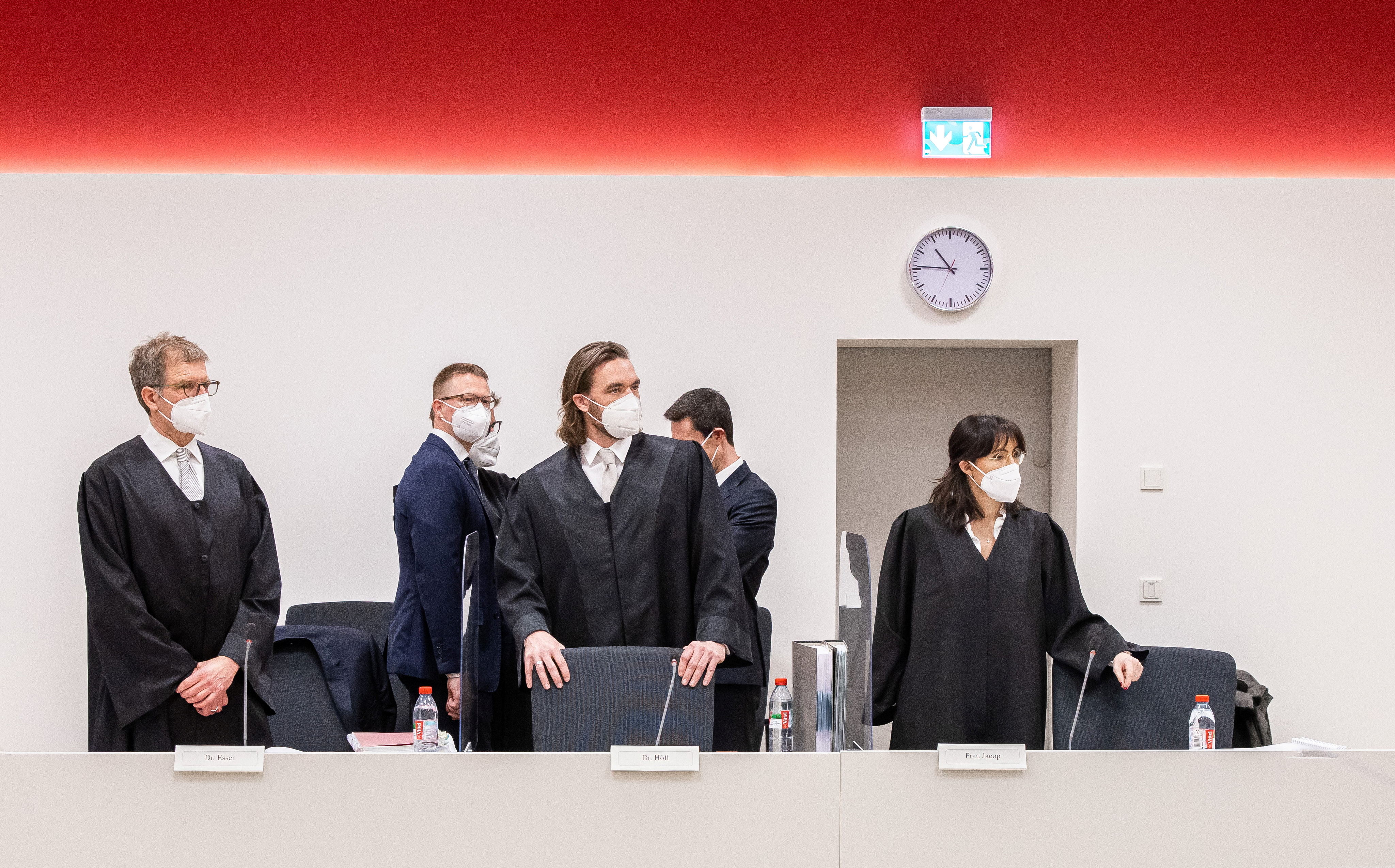 Facebook lawyers wait for the start of a hearing in Duesseldorf, Germany, March 24, 2021. The higher regional court in Duesseldorf hears Facebook's appeal against restrictions on its handling of user data ordered by Germany's Federal Cartel Office, in the latest installment of a two-year-old legal battle over the anti-trust regulator's ruling that the social network abused its market dominance.     Marcel Kusch/Pool via REUTERS
