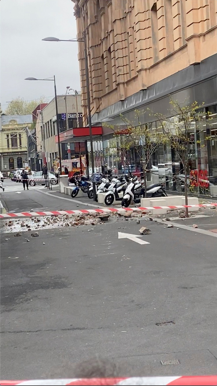 Debris from a damaged building are seen on a road in Prahran, after a magnitude 6.0 earthquake struck near Melbourne, Victoria, Australia, September 22, 2021, in this still image from video obtained via social media. Tom Robertson via REUTERS  ATTENTION EDITORS - THIS IMAGE HAS BEEN SUPPLIED BY A THIRD PARTY. MANDATORY CREDIT. NO RESALES. NO ARCHIVES.