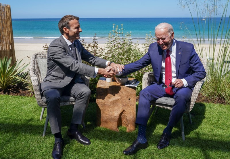 U.S. President Joe Biden and France's President Emmanuel Macron shake hands as they attend a bilateral meeting during the G7 summit in Carbis Bay, Cornwall, Britain, June 12, 2021. REUTERS/Kevin Lamarque