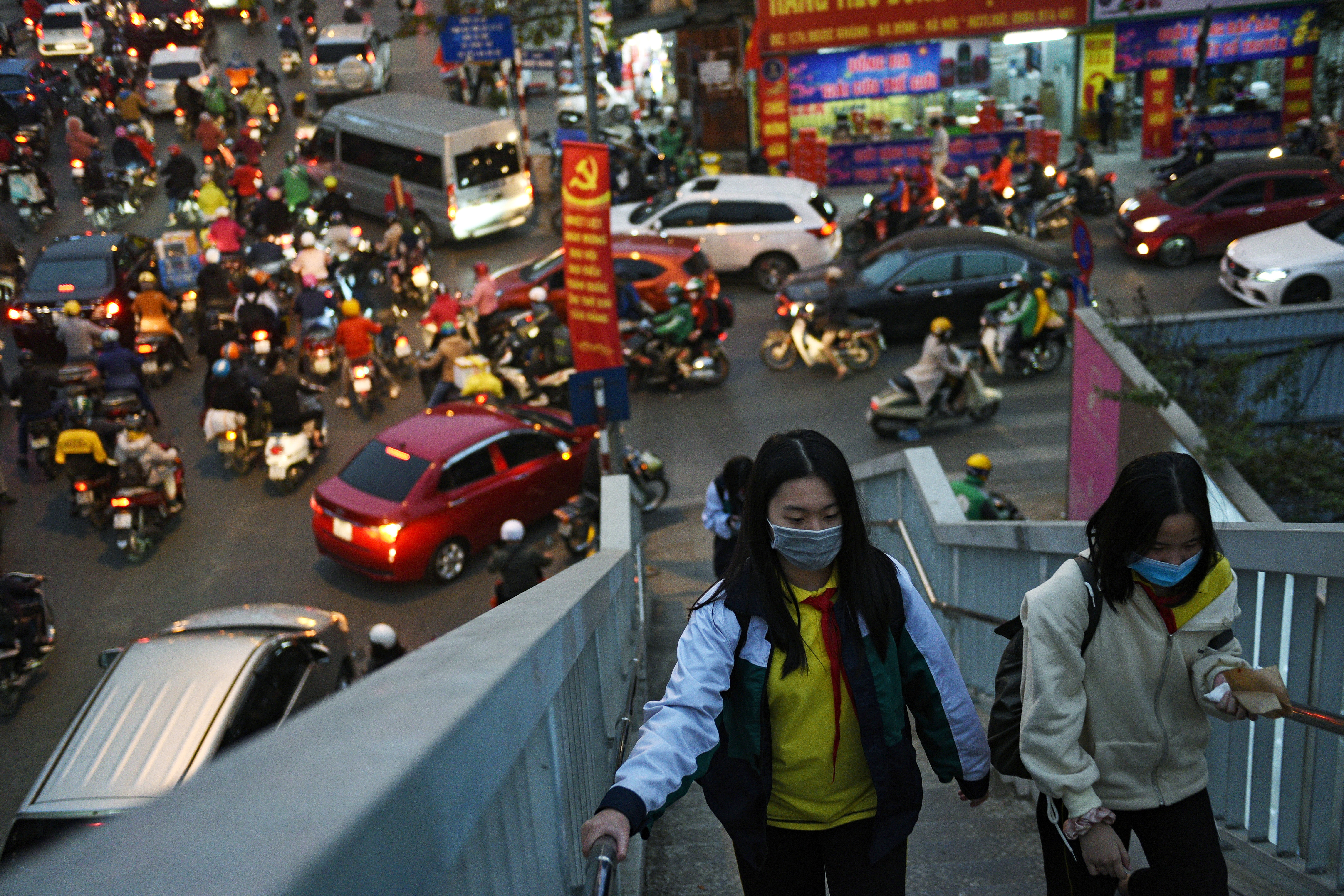 Gilrs walks in a overpass as they wear protective masks in the street amid the coronavirus disease (COVID-19) outbreak in Hanoi, Vietnam, January 29, 2021. REUTERS/Thanh Hue