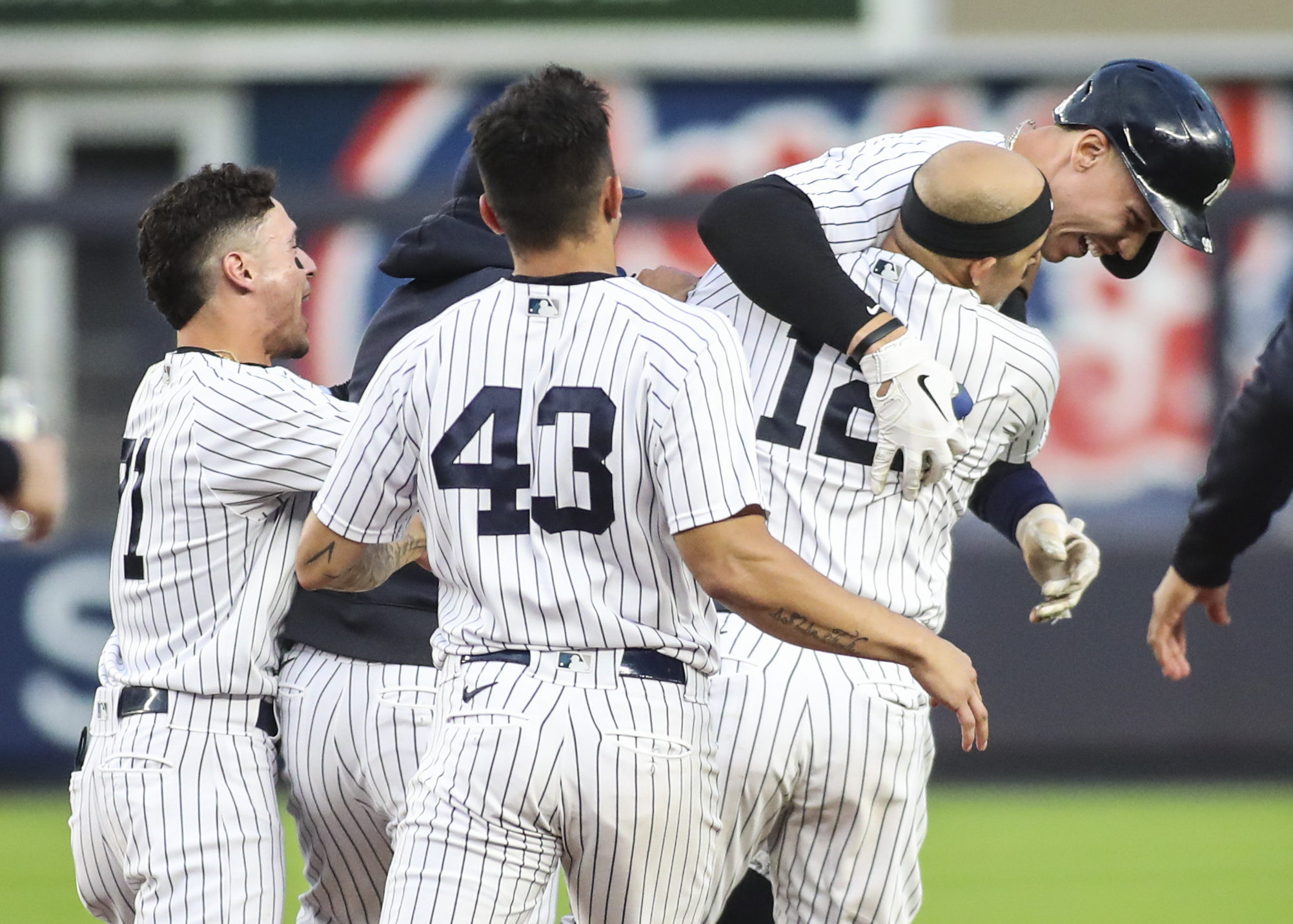 Oct 3, 2021; Bronx, New York, USA;  The New York Yankees mob right fielder Aaron Judge (99) after his game winning RBI single to defeat the Tampa Bay Rays 1-0 and clinch a wildcard playoff spot at Yankee Stadium. Mandatory Credit: Wendell Cruz-USA TODAY Sports