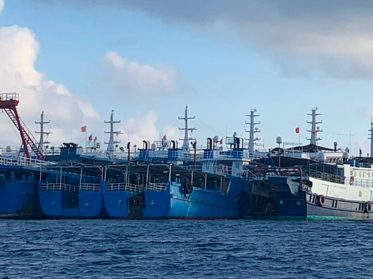 Chinese vessels, believed to be manned by Chinese maritime militia personnel, are seen at Whitsun Reef, South China Sea on March 27, 2021. Philippine Coast Guard/National Task Force-West Philippine Sea/Handout via REUTERS